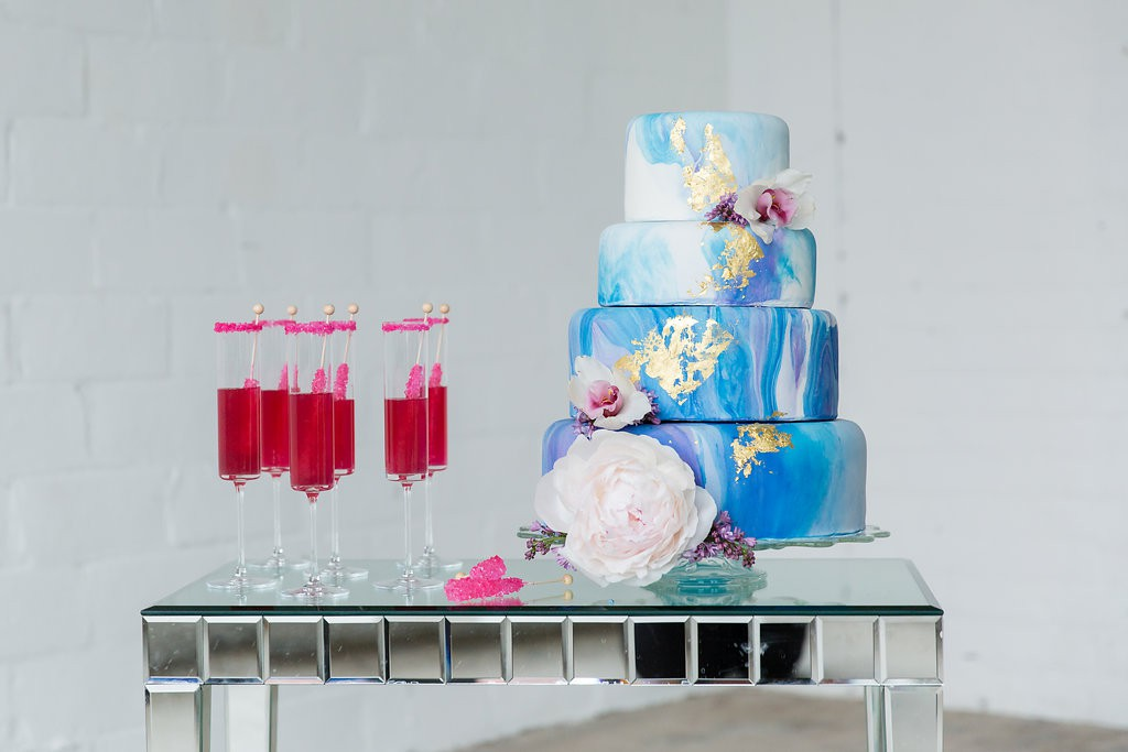 Watercolor wedding cake with pink champagne