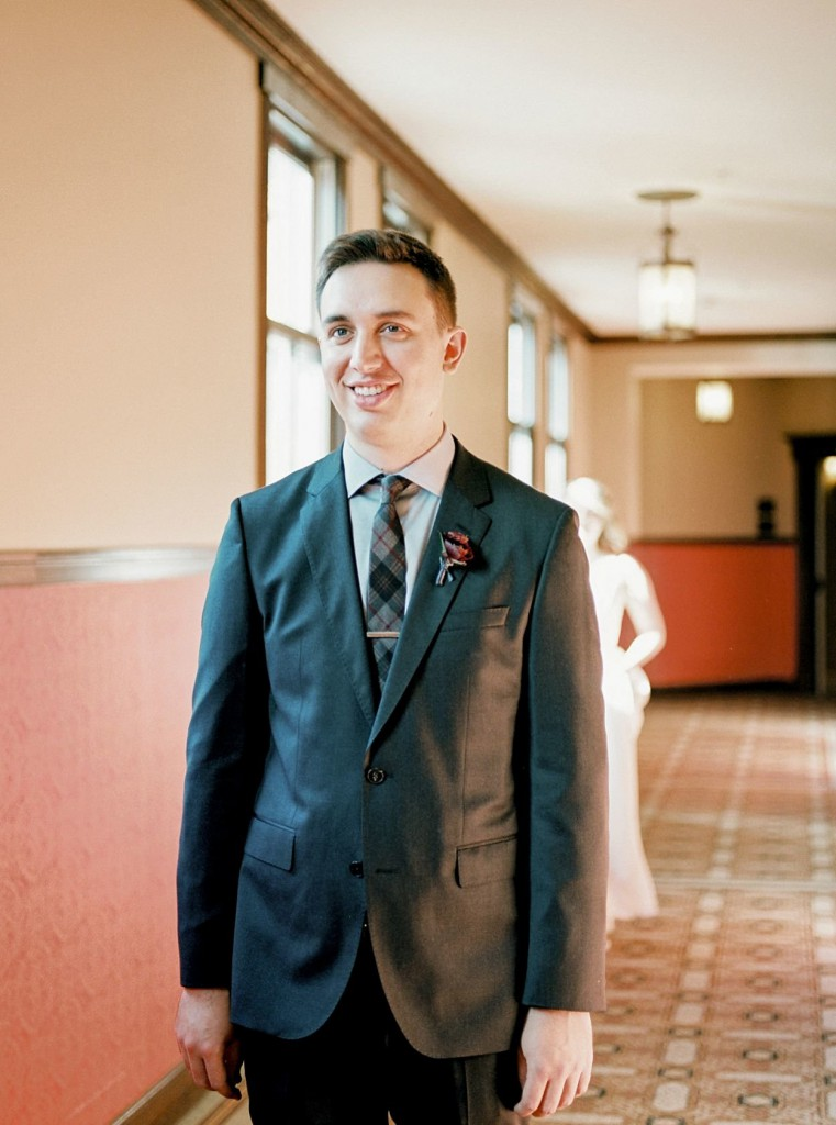 Groom awaiting bride for first look