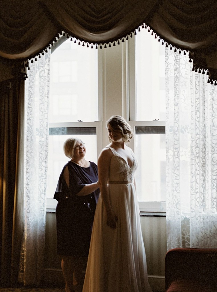 Bride and mother before wedding ceremony