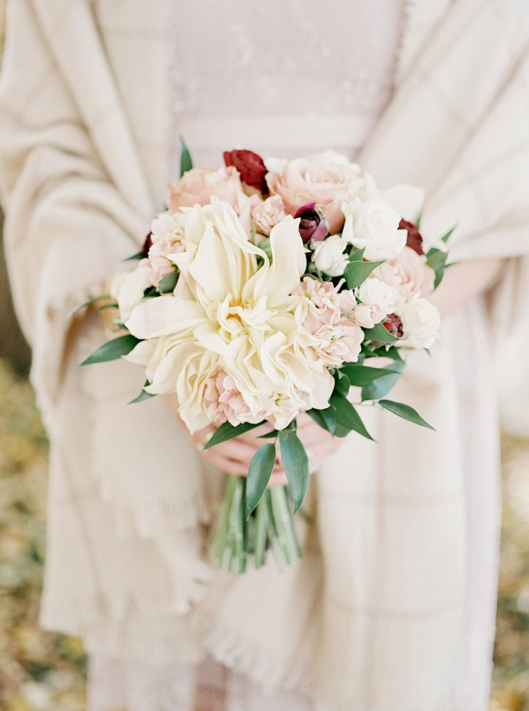 Bridesmaids bouquet made with Fall florals in pink, peach and red shades with Dahlias, roses, hydrangea, greenery