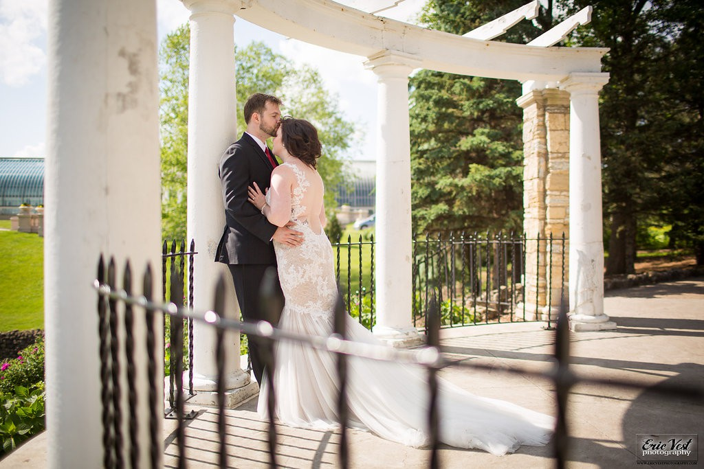 bride and groom kiss on wedding day