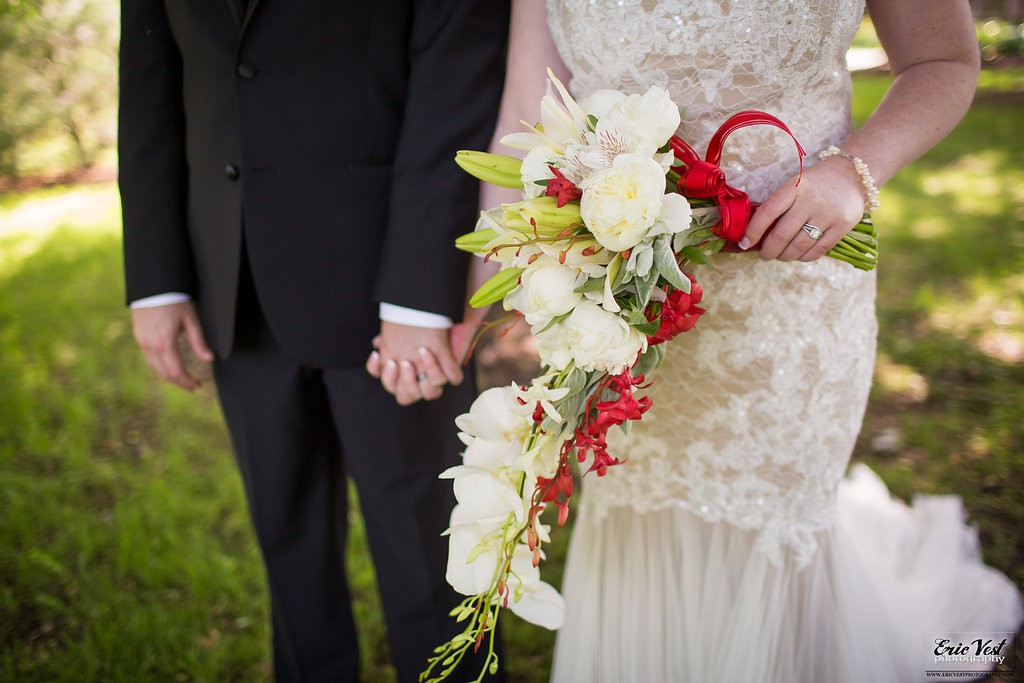 red and white bouquet made with orchids, peonies and lillies
