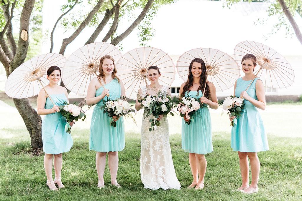 Bride and bridesmaids with parisols