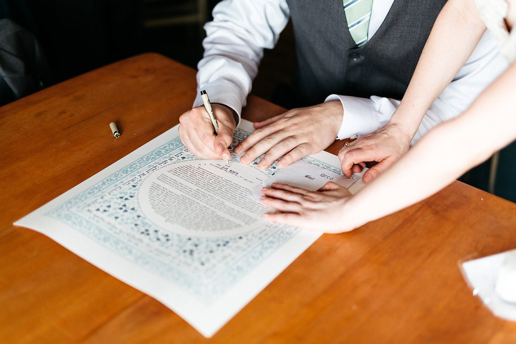 Groom signing of the Ketubah, Jewish wedding contract