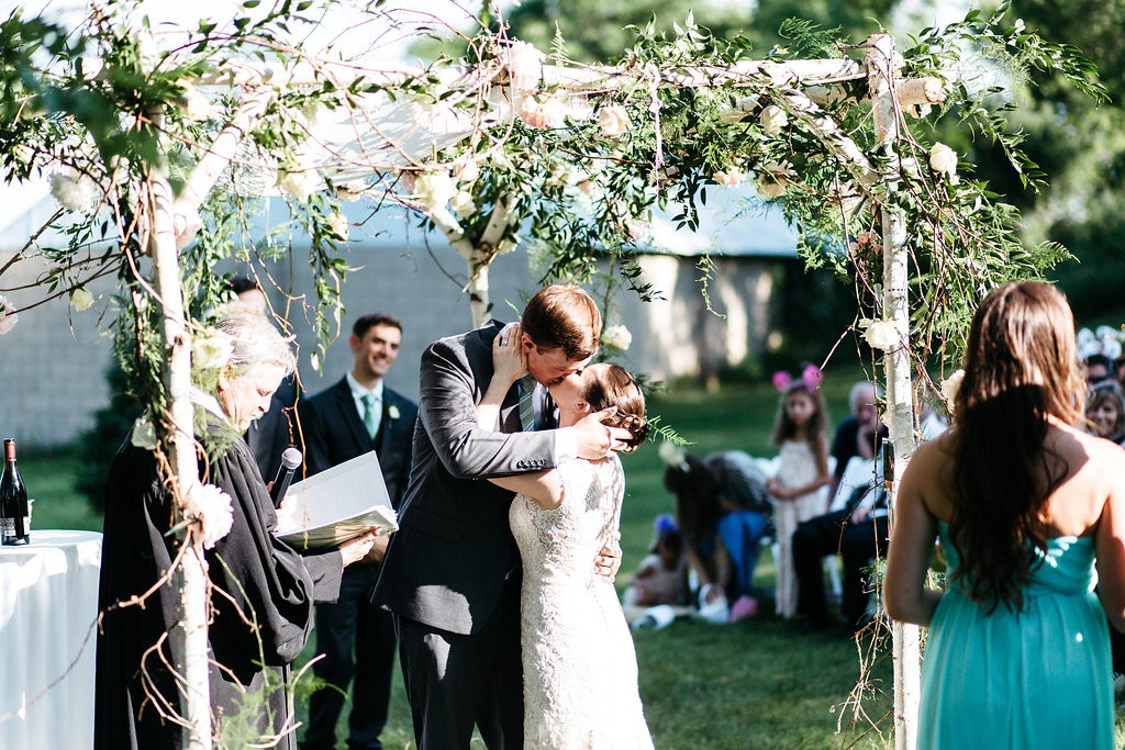 bride and groom's first kiss during Jewish wedding ceremony