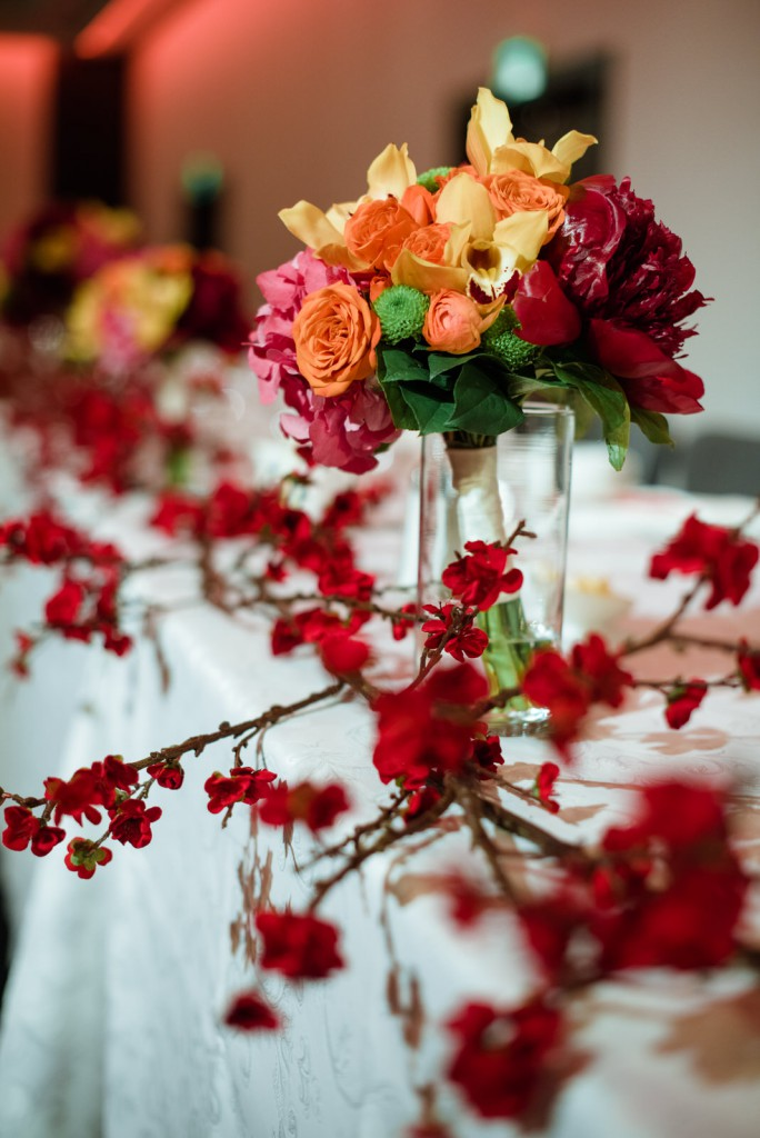 colorful wedding decor with red, pink, orange an dyellow