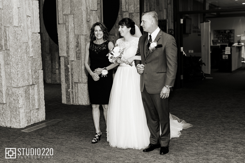 Bride walking down the aisle with parents