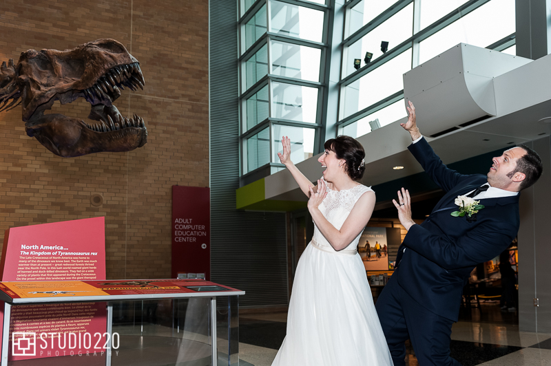 Bride and groom with dinosaur