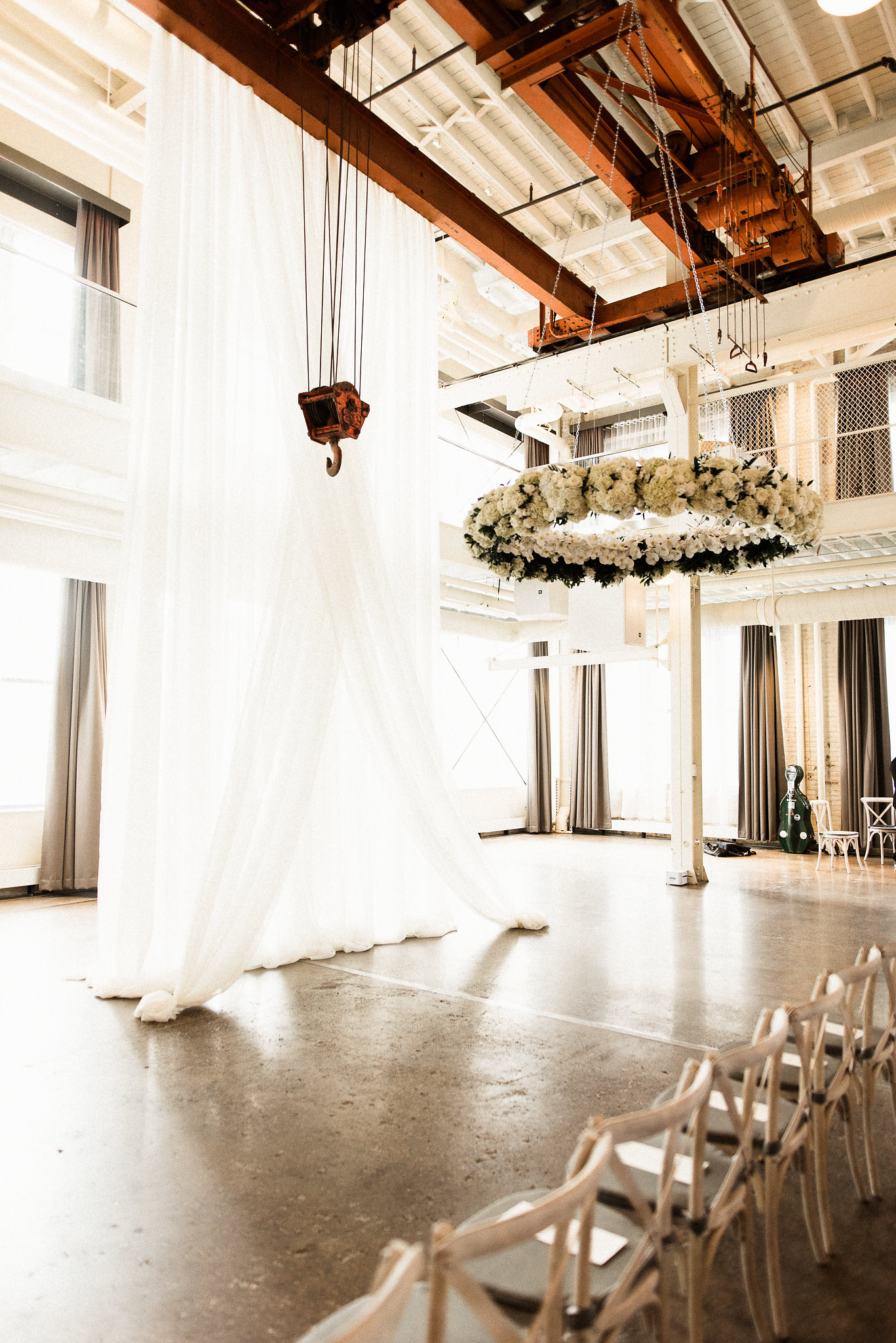 MN wedding with a hanging floral installation