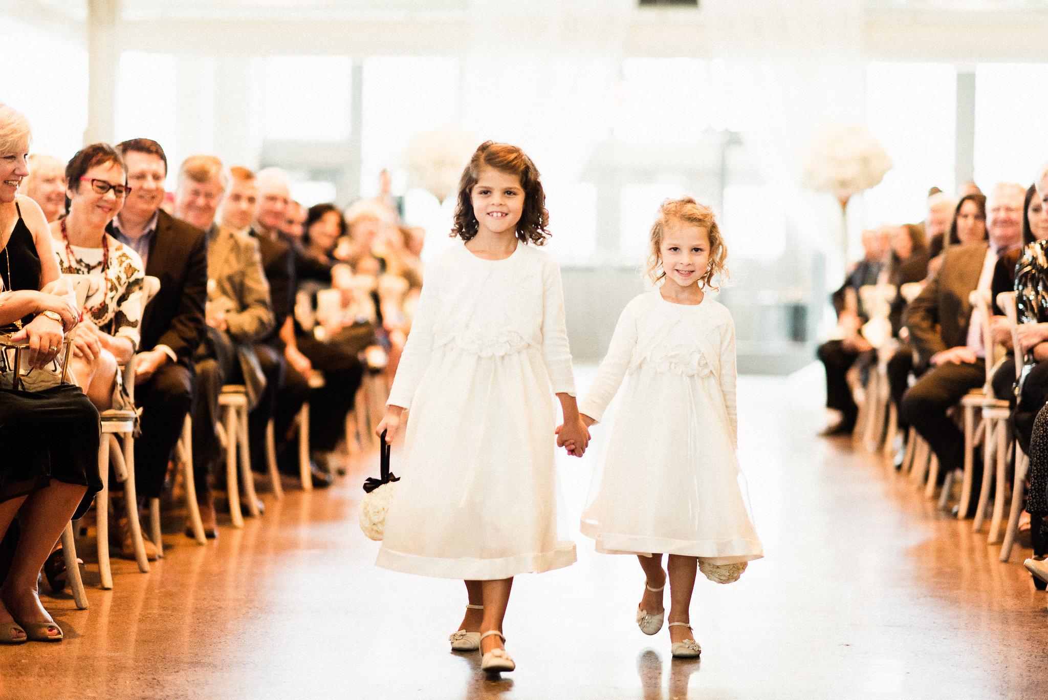 little girls walking down the aisle