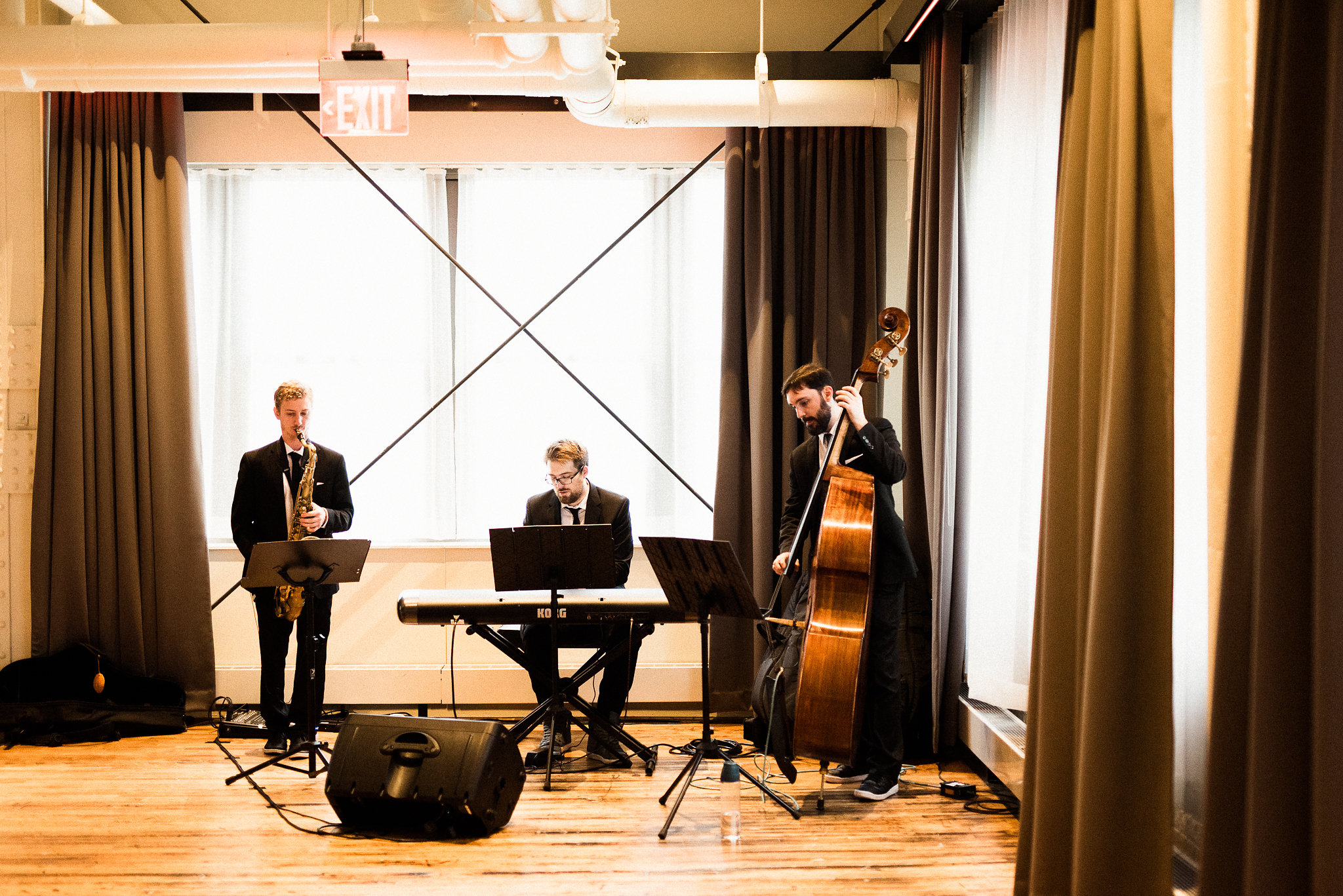 saxophonist, pianist, and bassist at a wedding