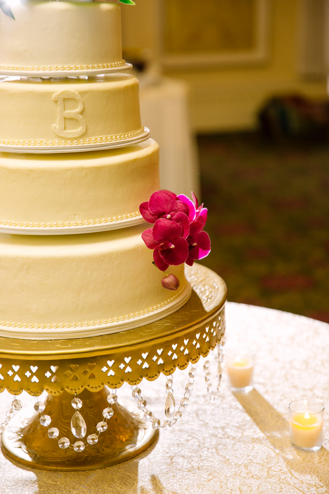 white wedding cake with a pink flower