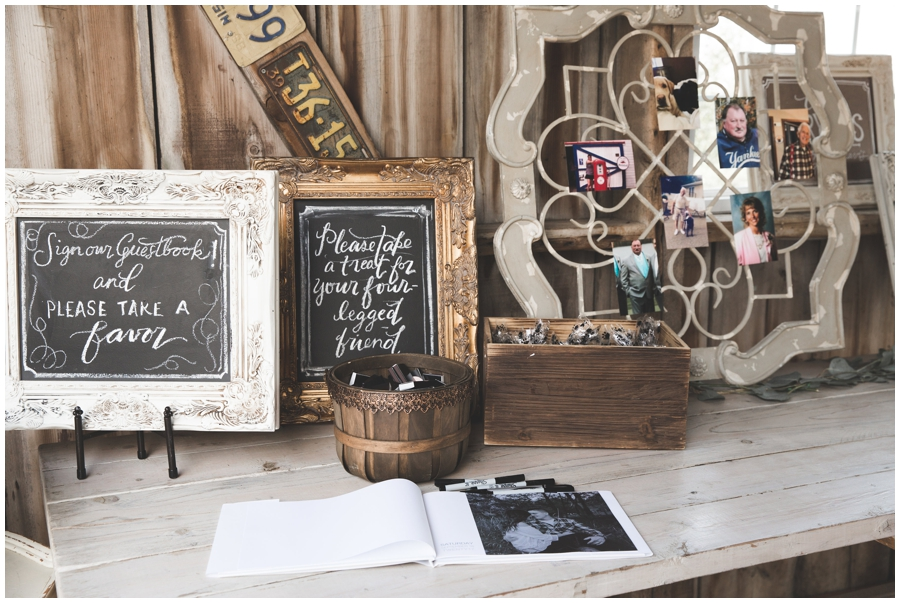 guest book table with photos
