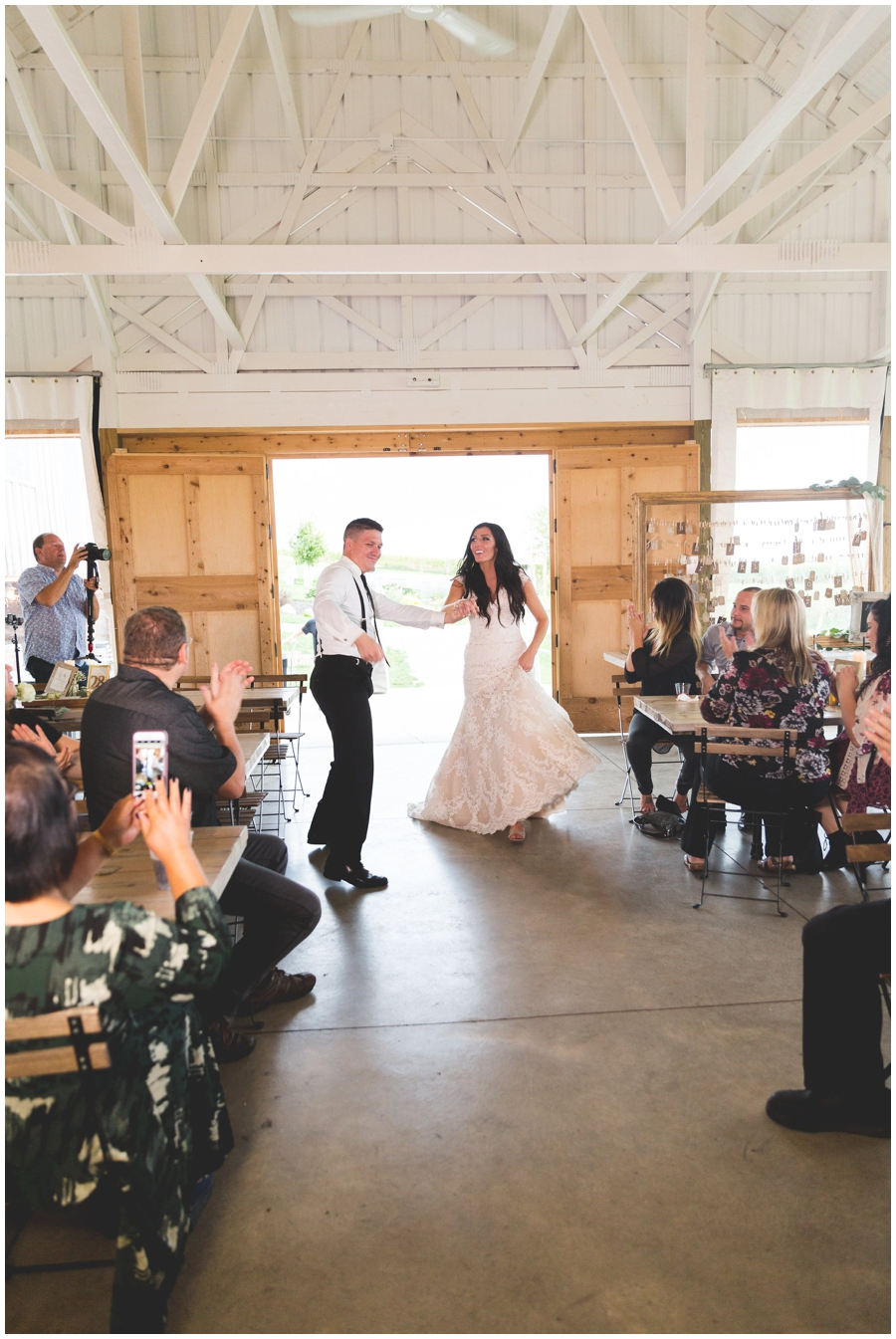 bride and groom entering their reception at the Legacy Hill Farm