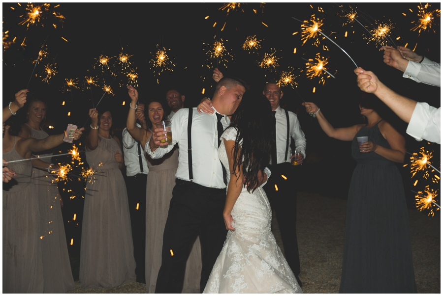 bride and groom surrounded by sparklers at their wedding