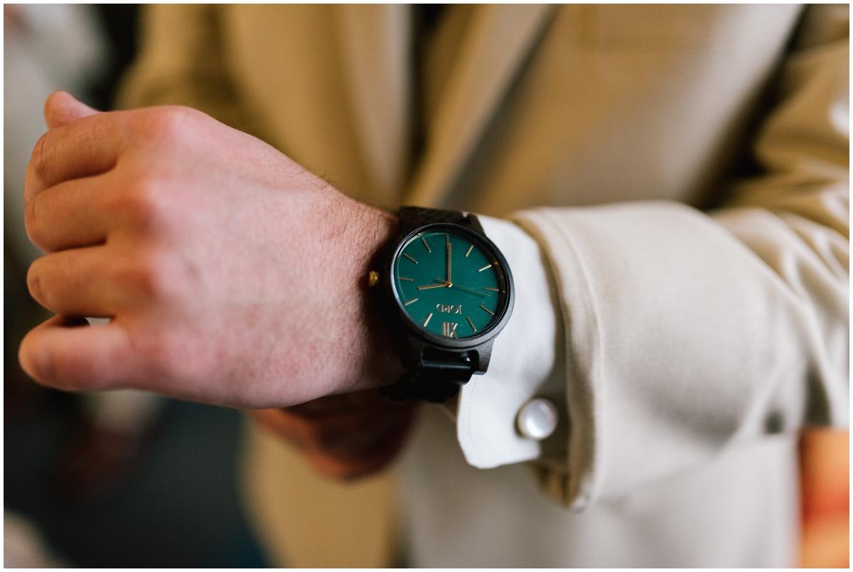 Groom wearing a greenery, fashion forward watch