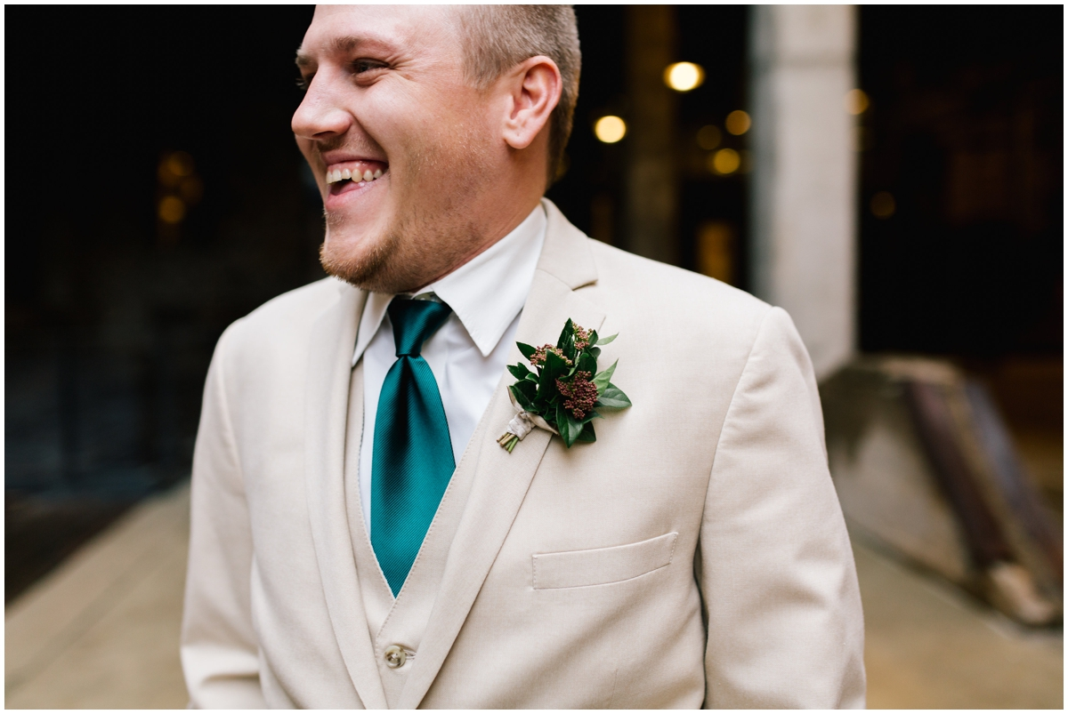 Groom with a greenery tie and boutonneire