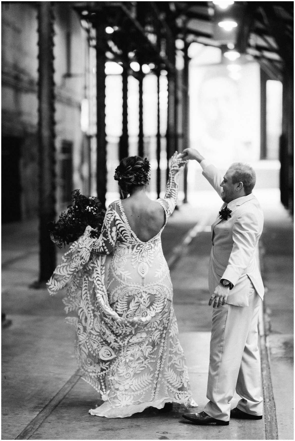 Bride and groom dancing at their first look shoot
