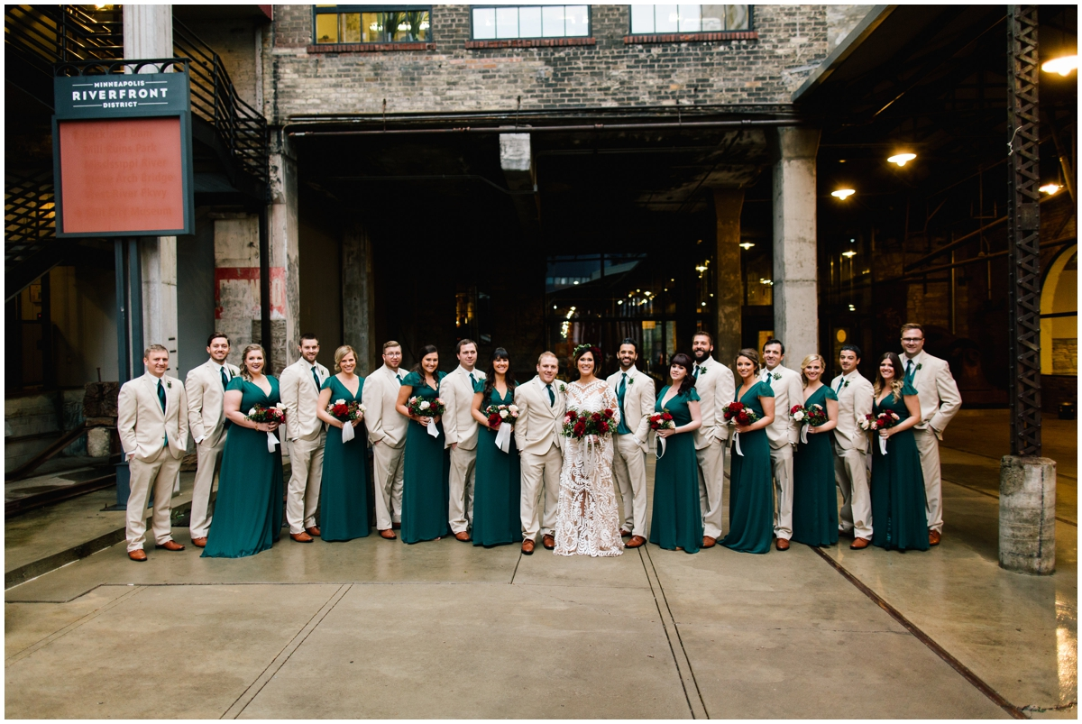 Bridal party with greenery dresses and ties.