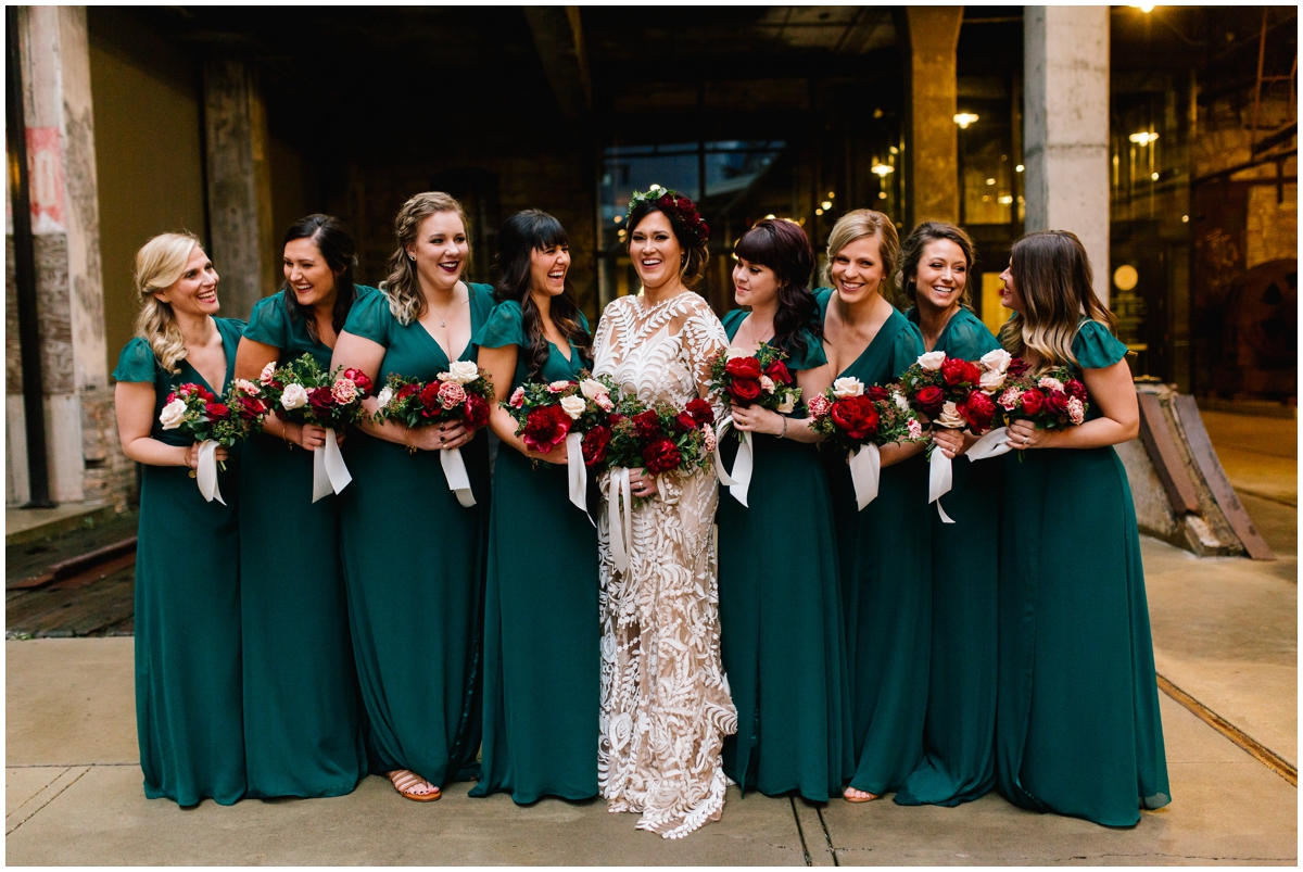 Bride and her bridesmaids with burgundy peony bouquets.