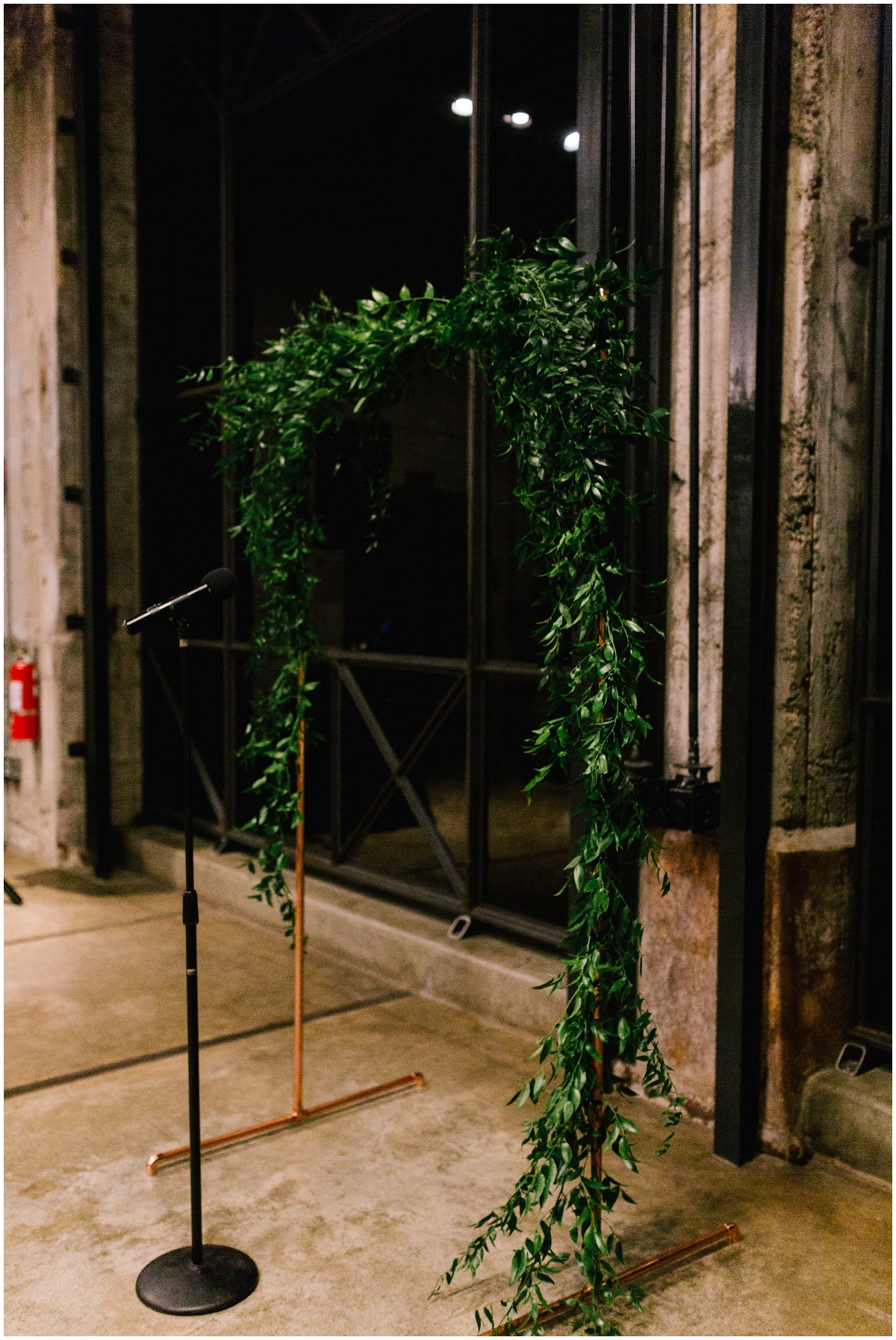 Garland draped ceremony arch, Mill City Museum wedding planned by MN Wedding Planner, Rosetree Weddings & Events