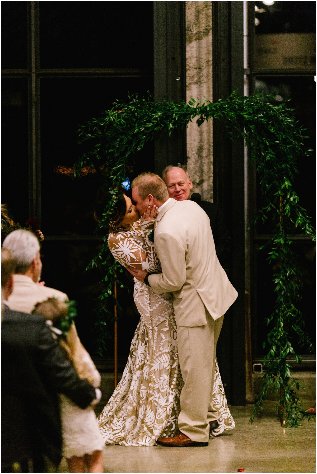 Bride and groom kiss at their ceremony
