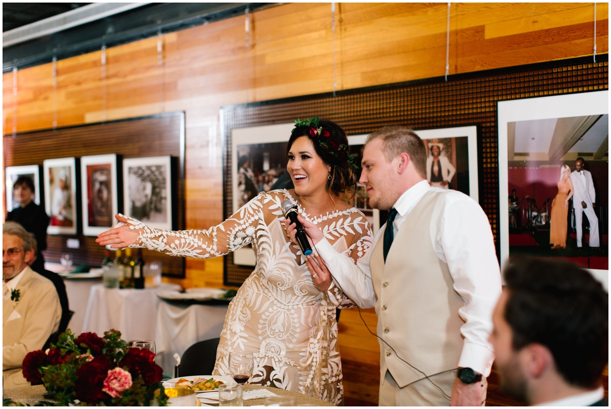 Bride and groom at their greenery and burgundy themed wedding