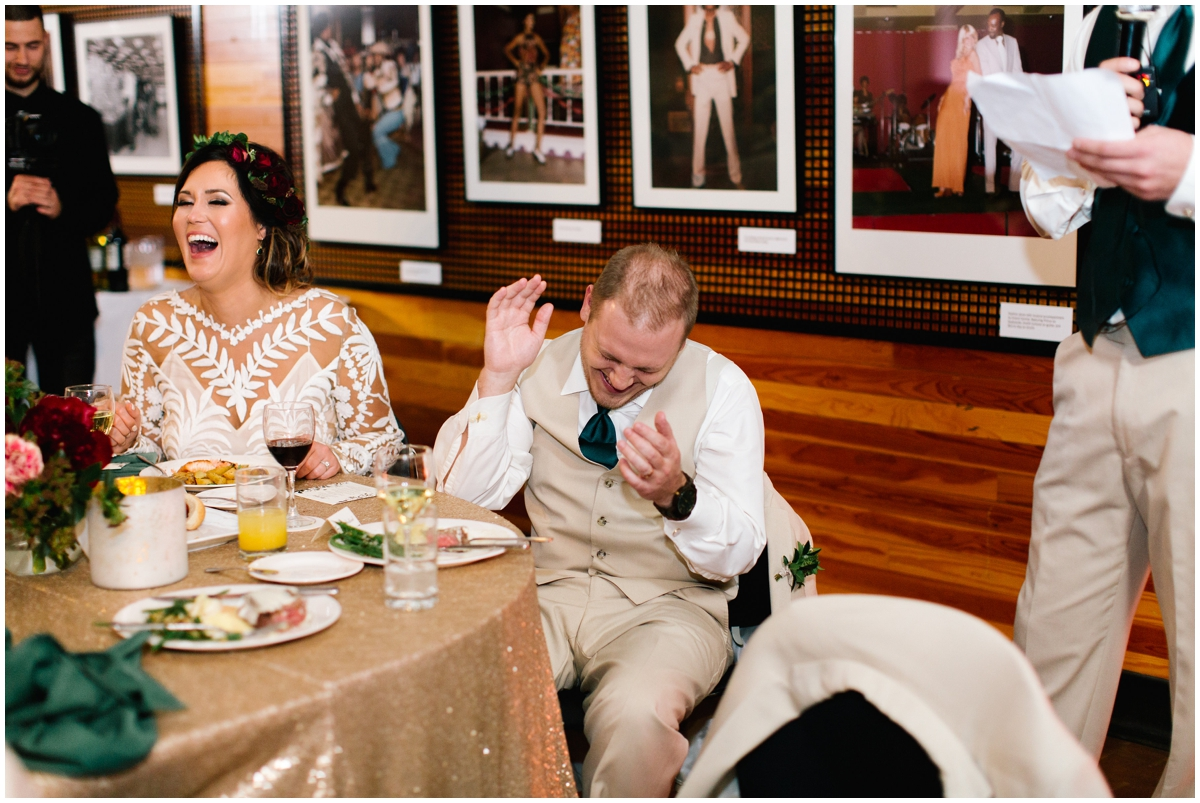 Bride and groom having dinner at their wedding reception