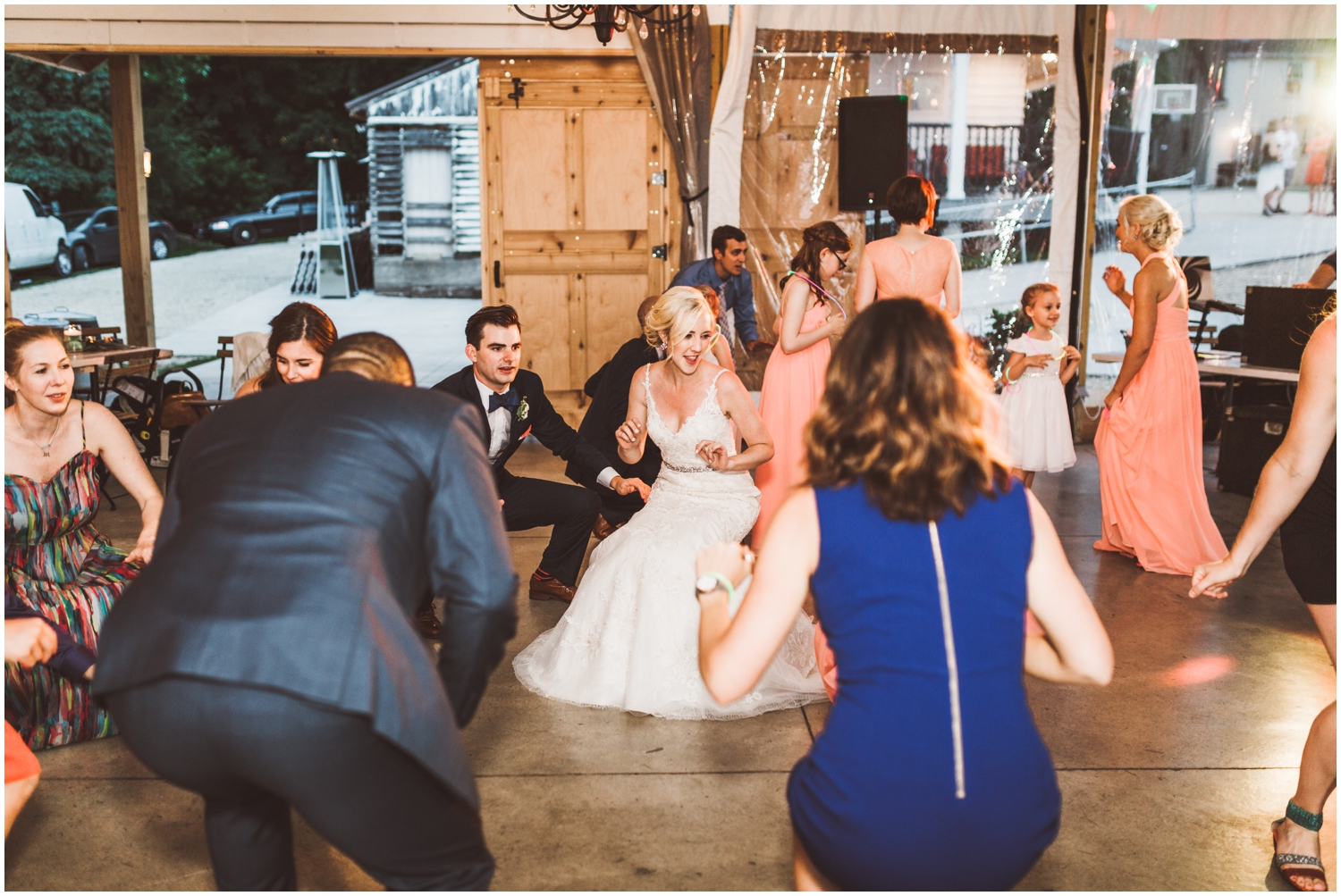 bride and groom dancing with their guests