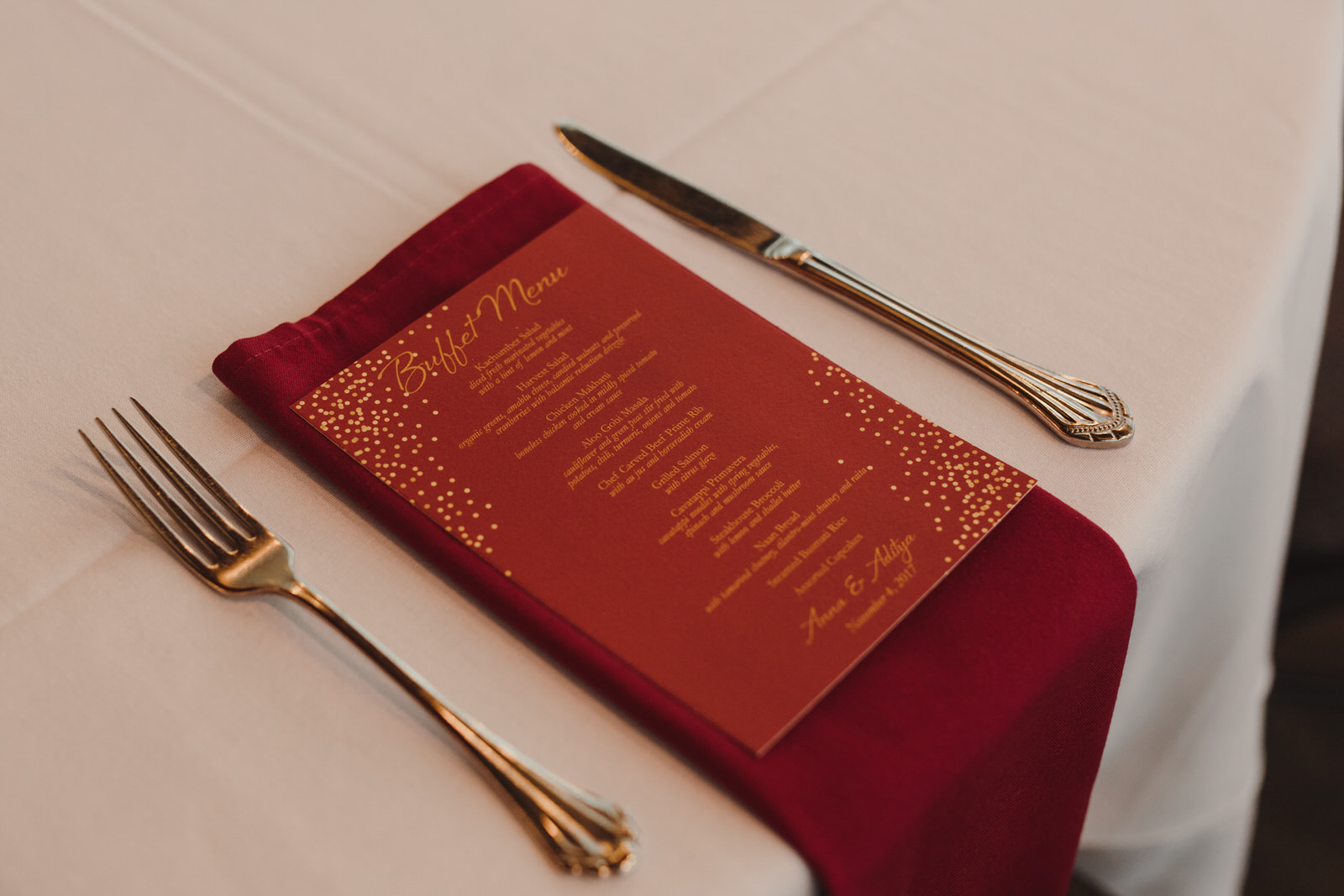 red tablescape and menu for wedding