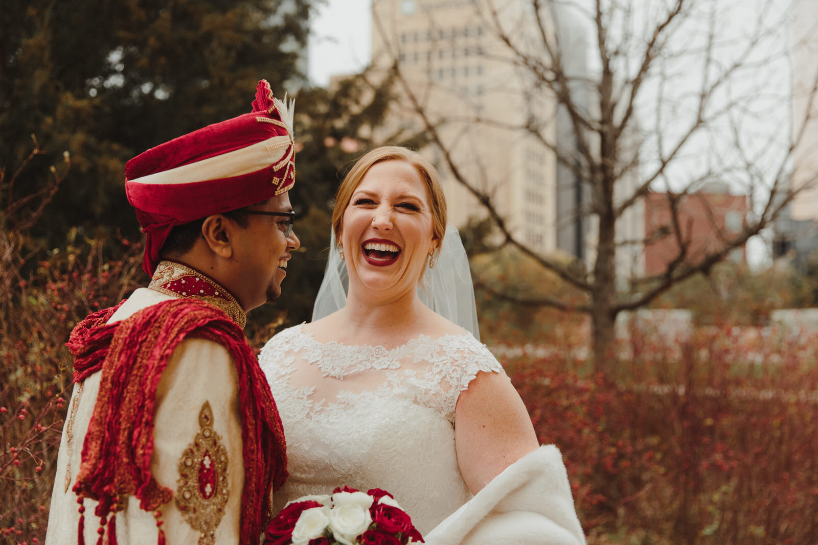 bride and groom laughing