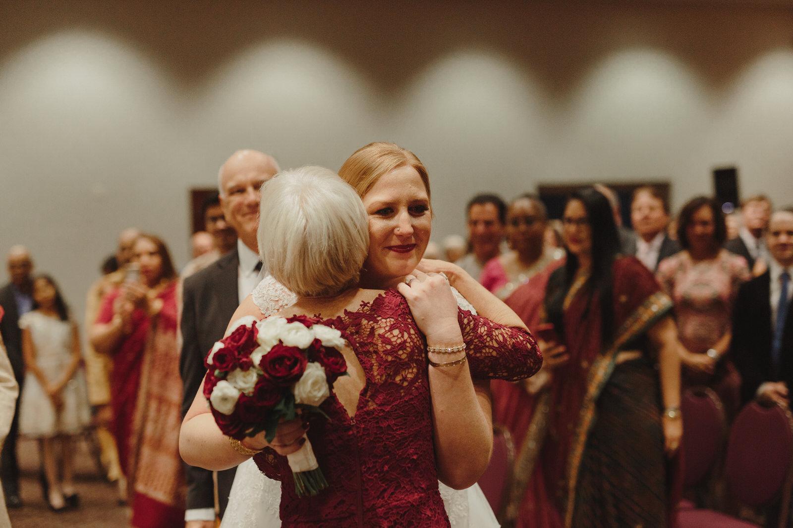 bride hugging guests at wedding