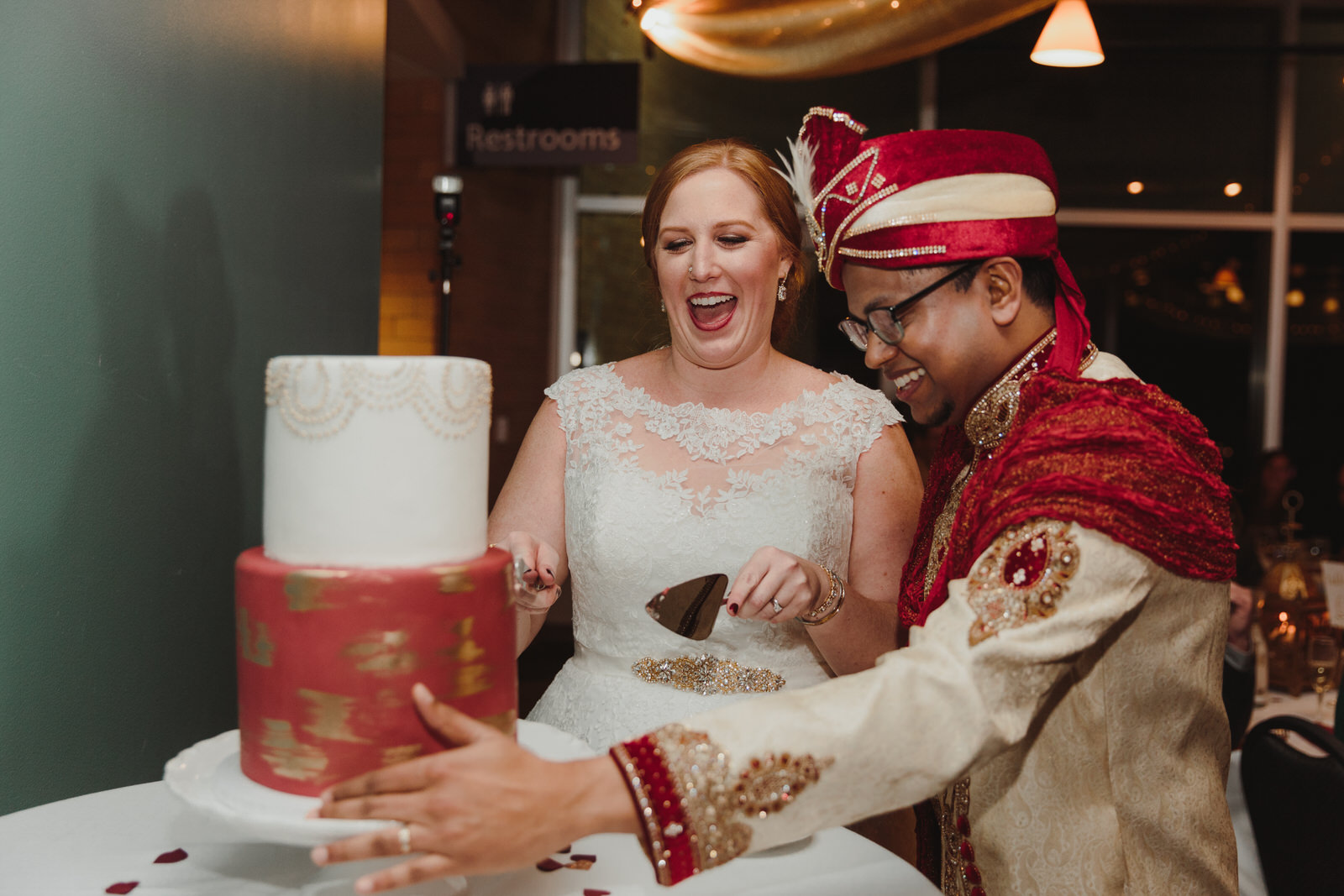 bride and groom cutting their wedding cake together