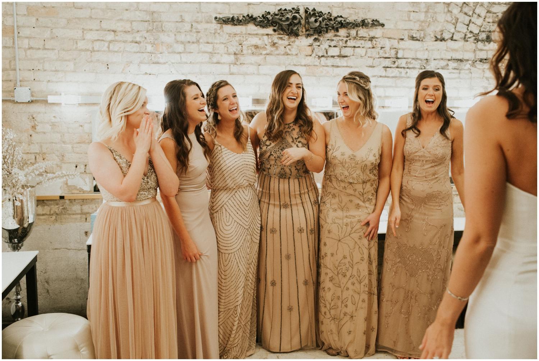 Bridesmaids looking at the beautiful bride