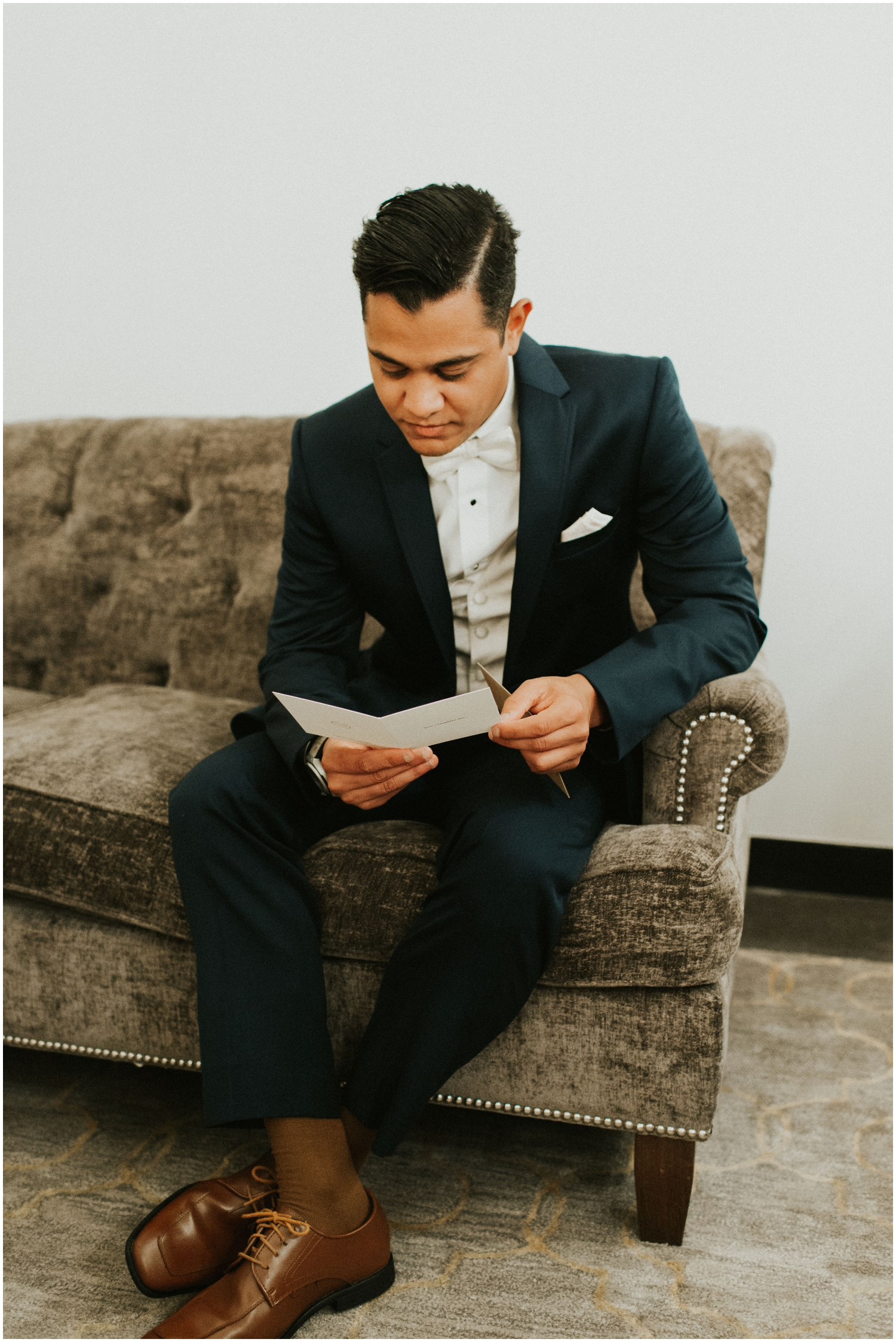 Groom reading a letter from the Bride