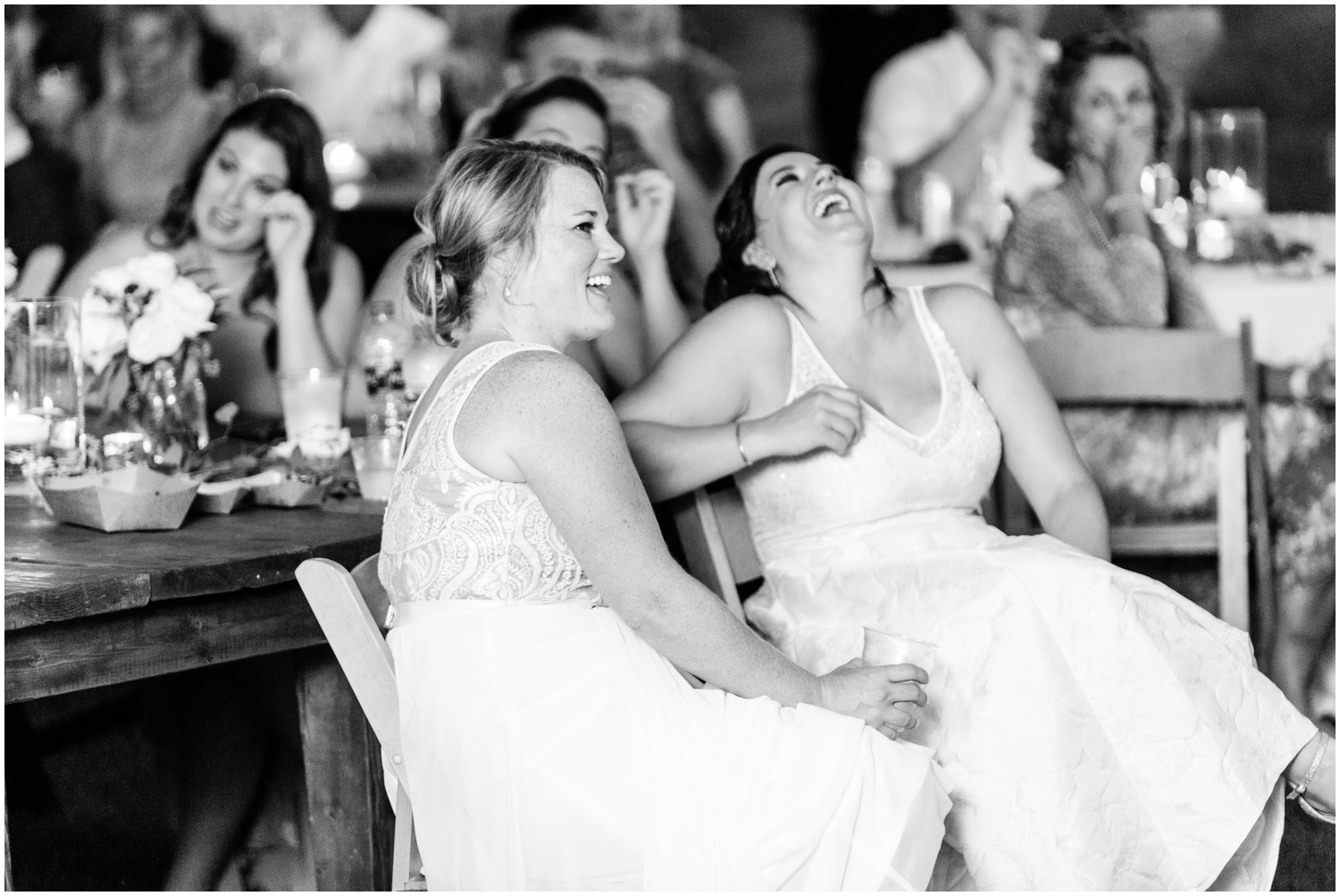 the Brides laughing at their wedding in MN
