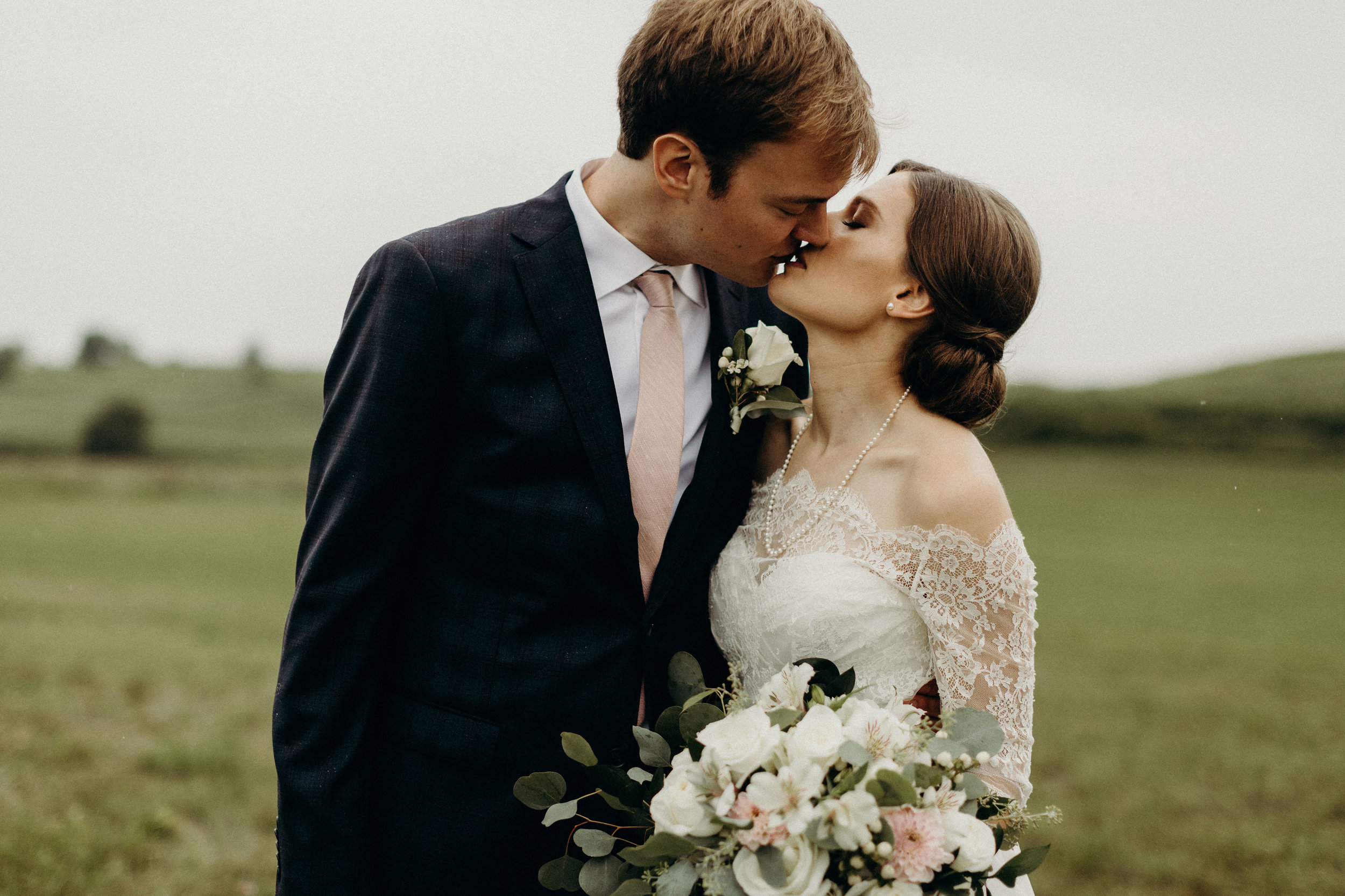 Bride and groom kiss before their wedding