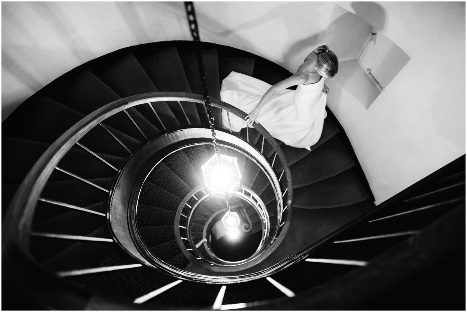 Minnesota Wedding Planner. Lafayette Club Wedding. Bride walking down a stairwell