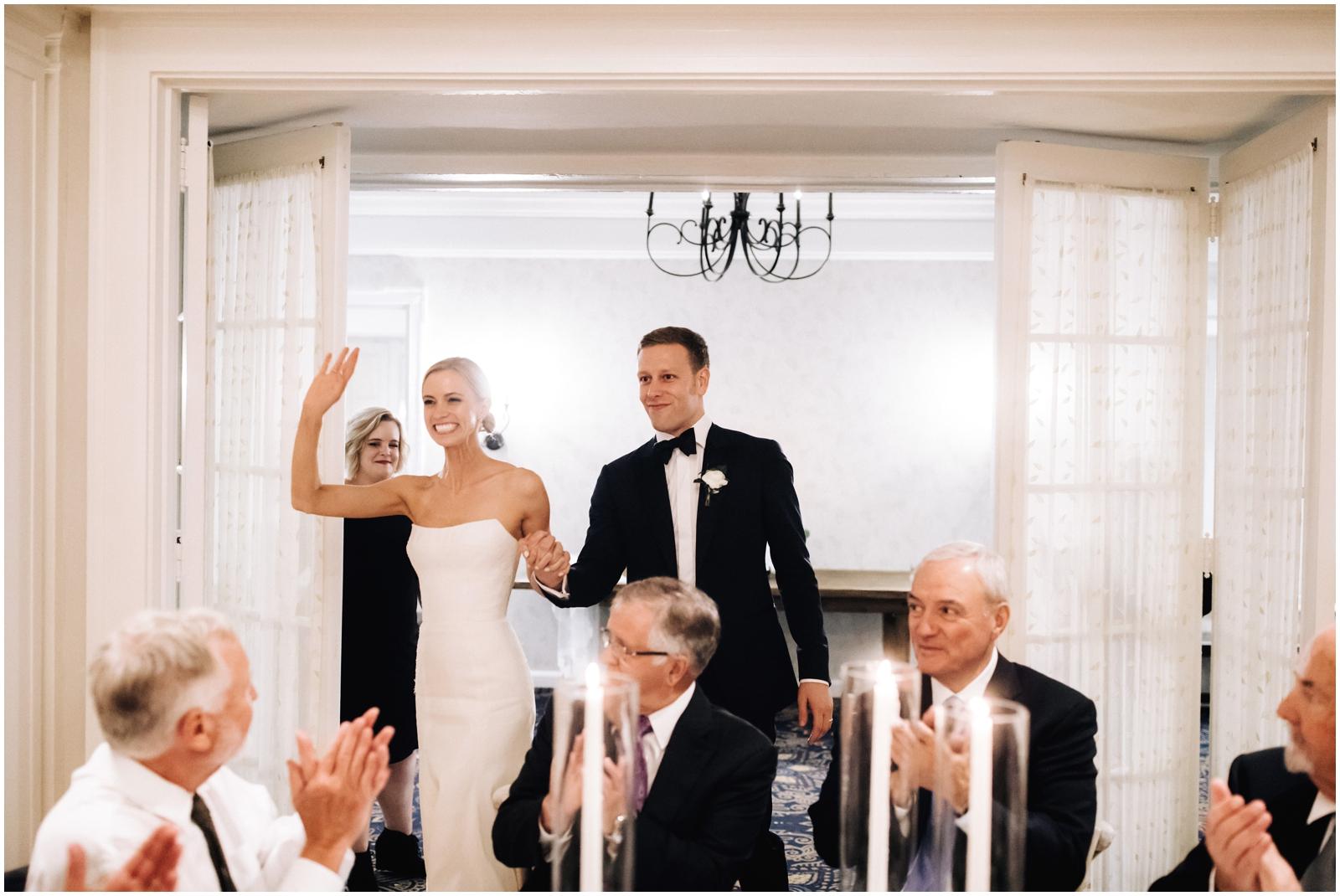 Minnesota Wedding Planner. Lafayette Club Wedding. Wedding Reception Inspiration. Wedding Decor. Greenery Wedding. Bride and groom walking into the reception