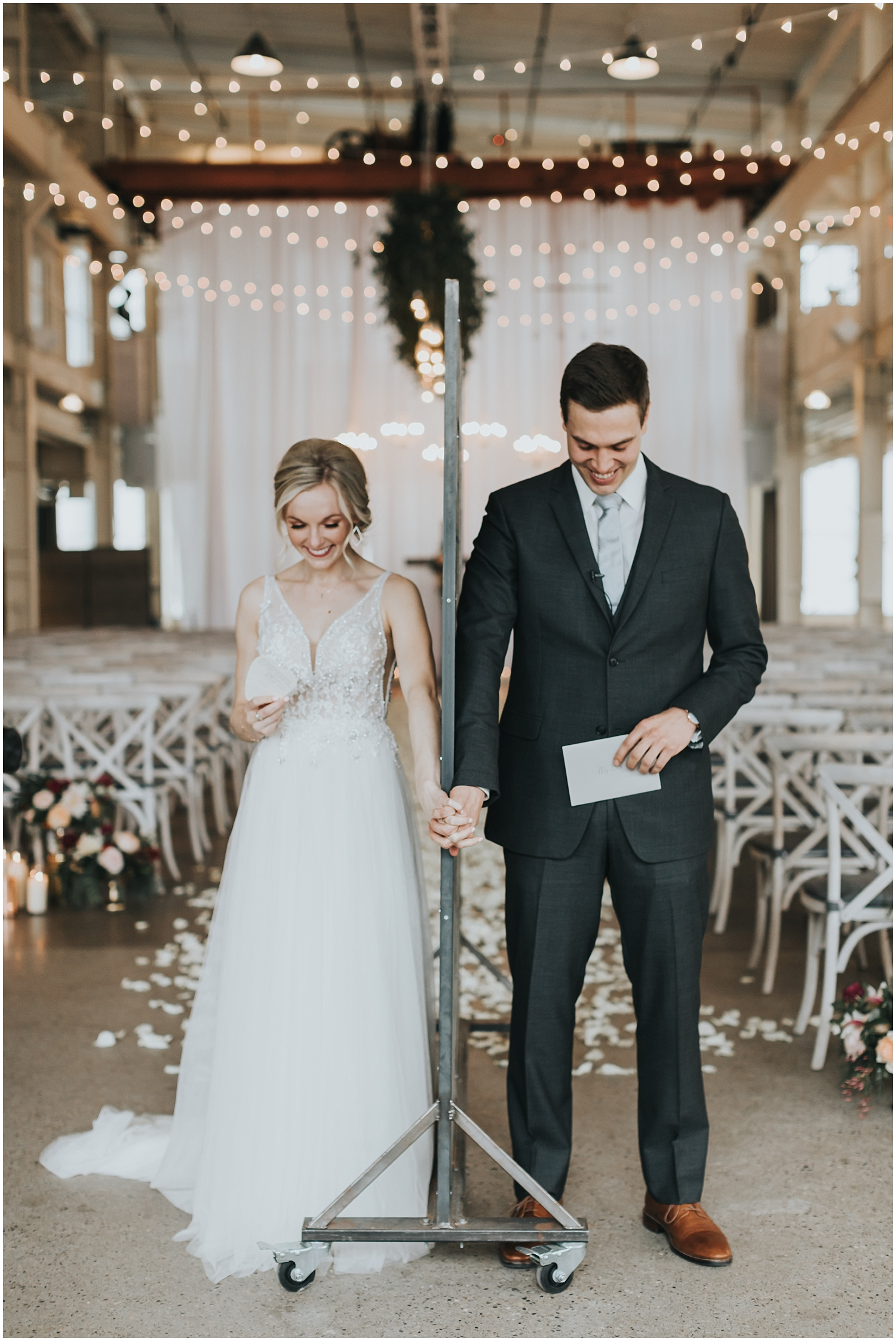 bride and groom holding hands before their wedding ceremony