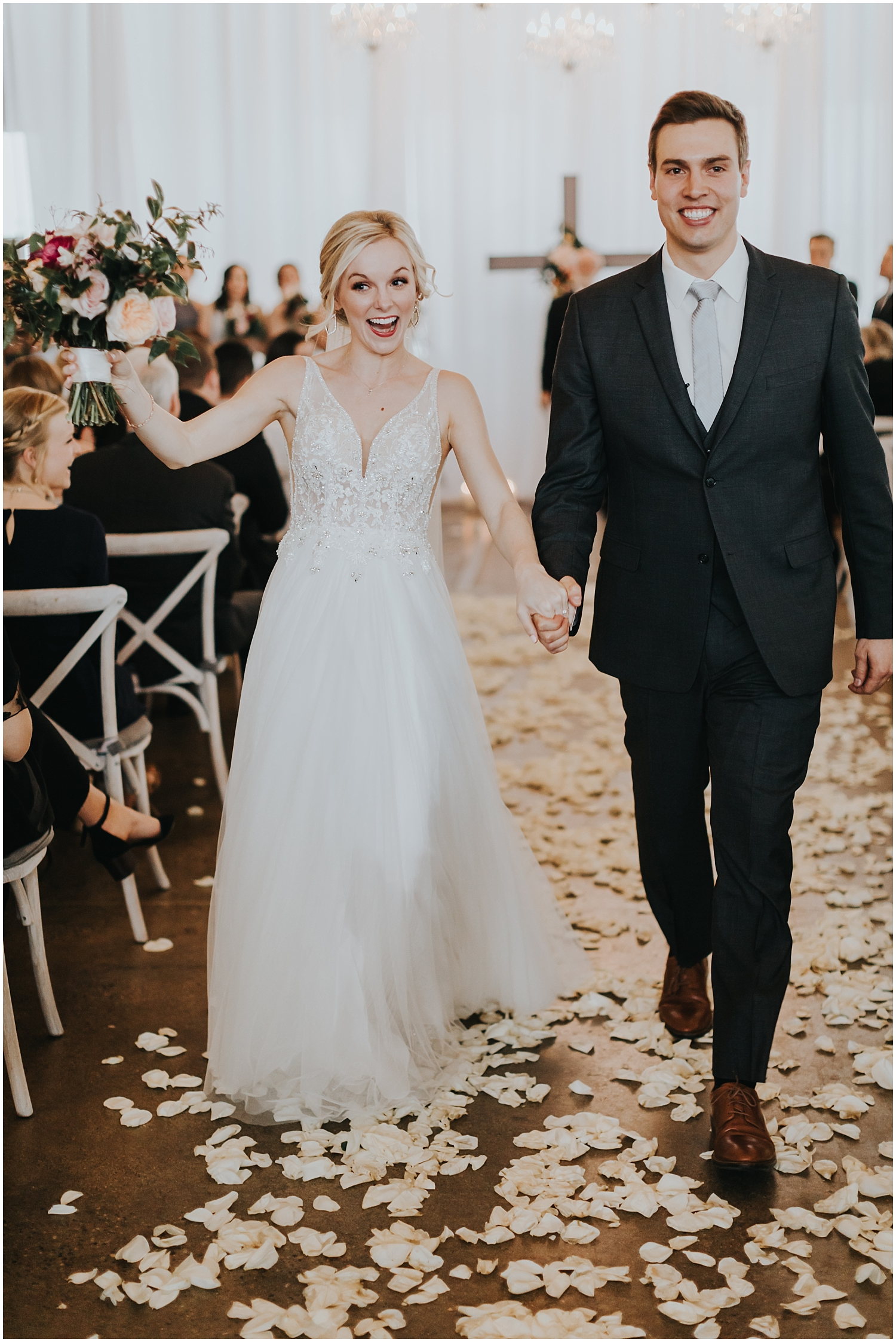 bride and groom smiling after their wedding ceremony