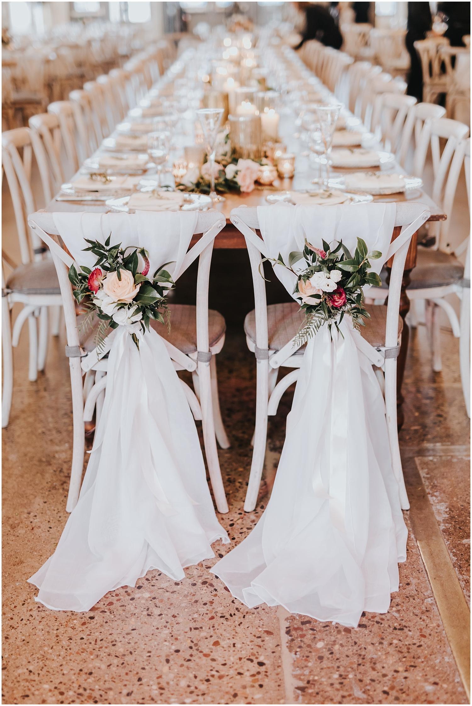 bride and groom's wedding chair decor