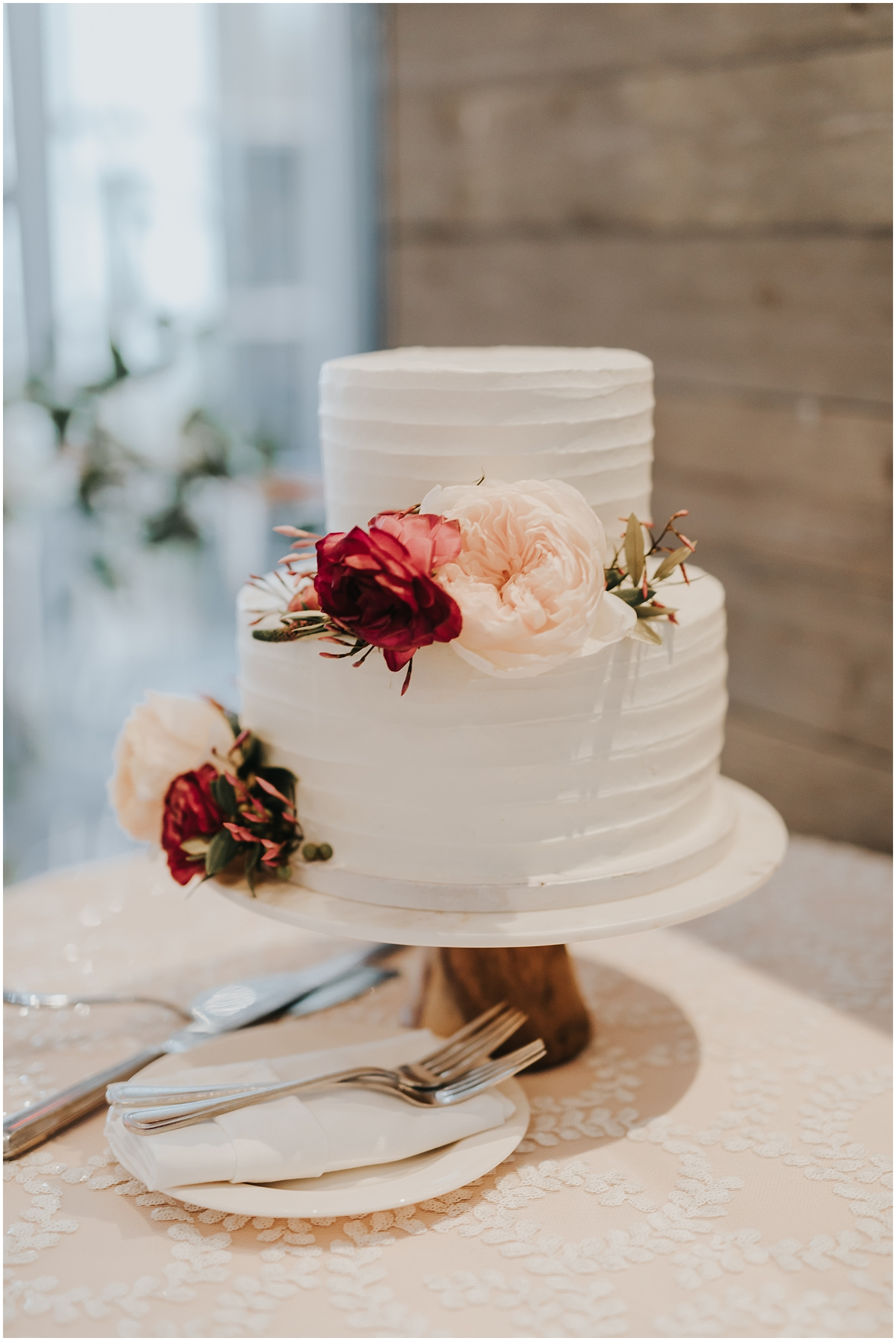 white wedding cake with floral decor
