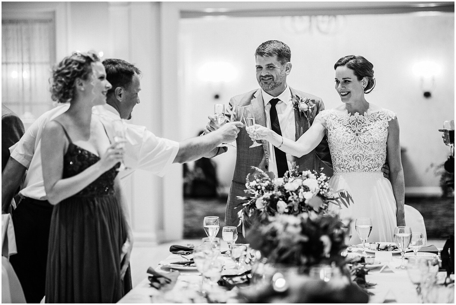 couple making a toast with wedding guests