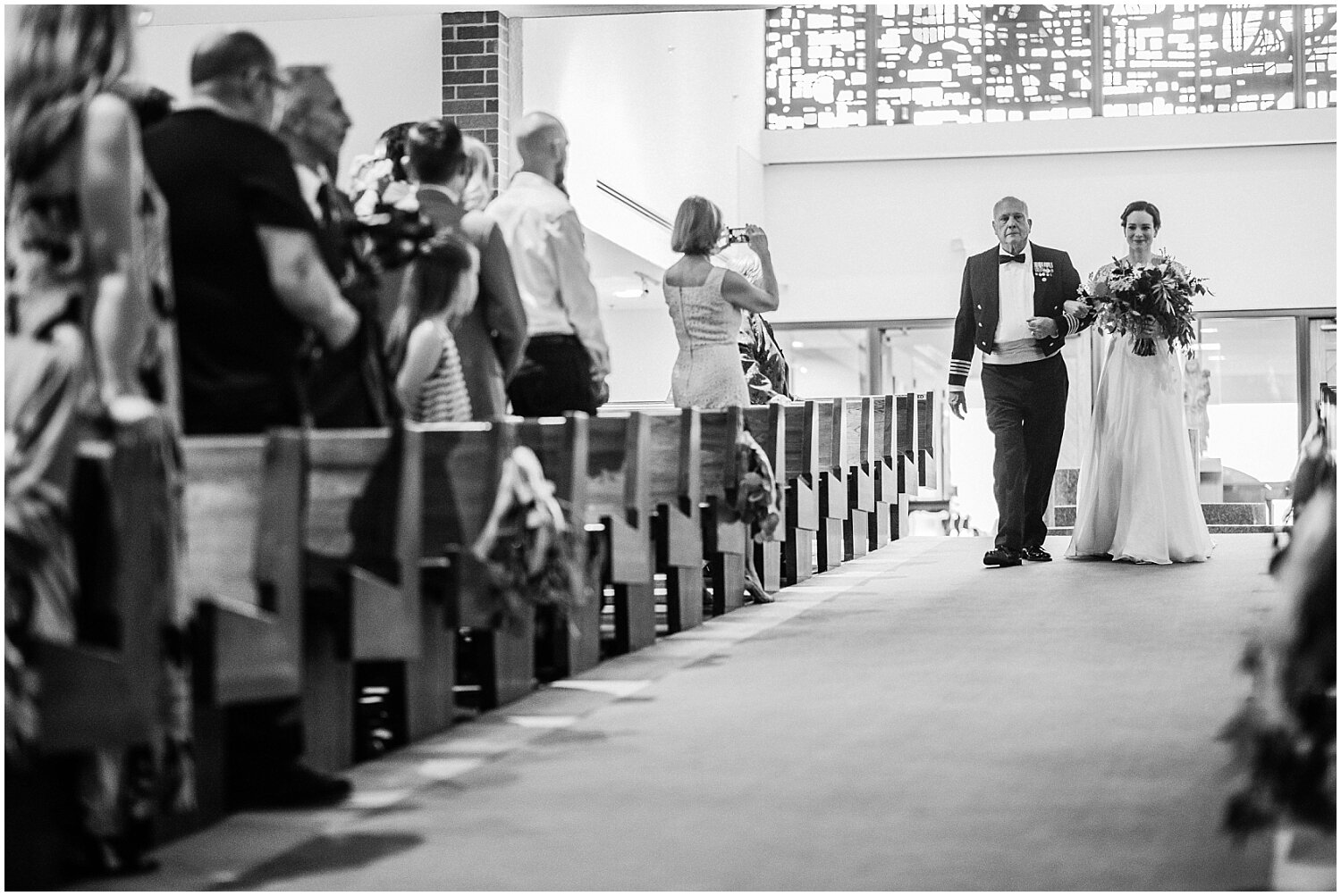 bride walking down the aisle in wedding ceremony