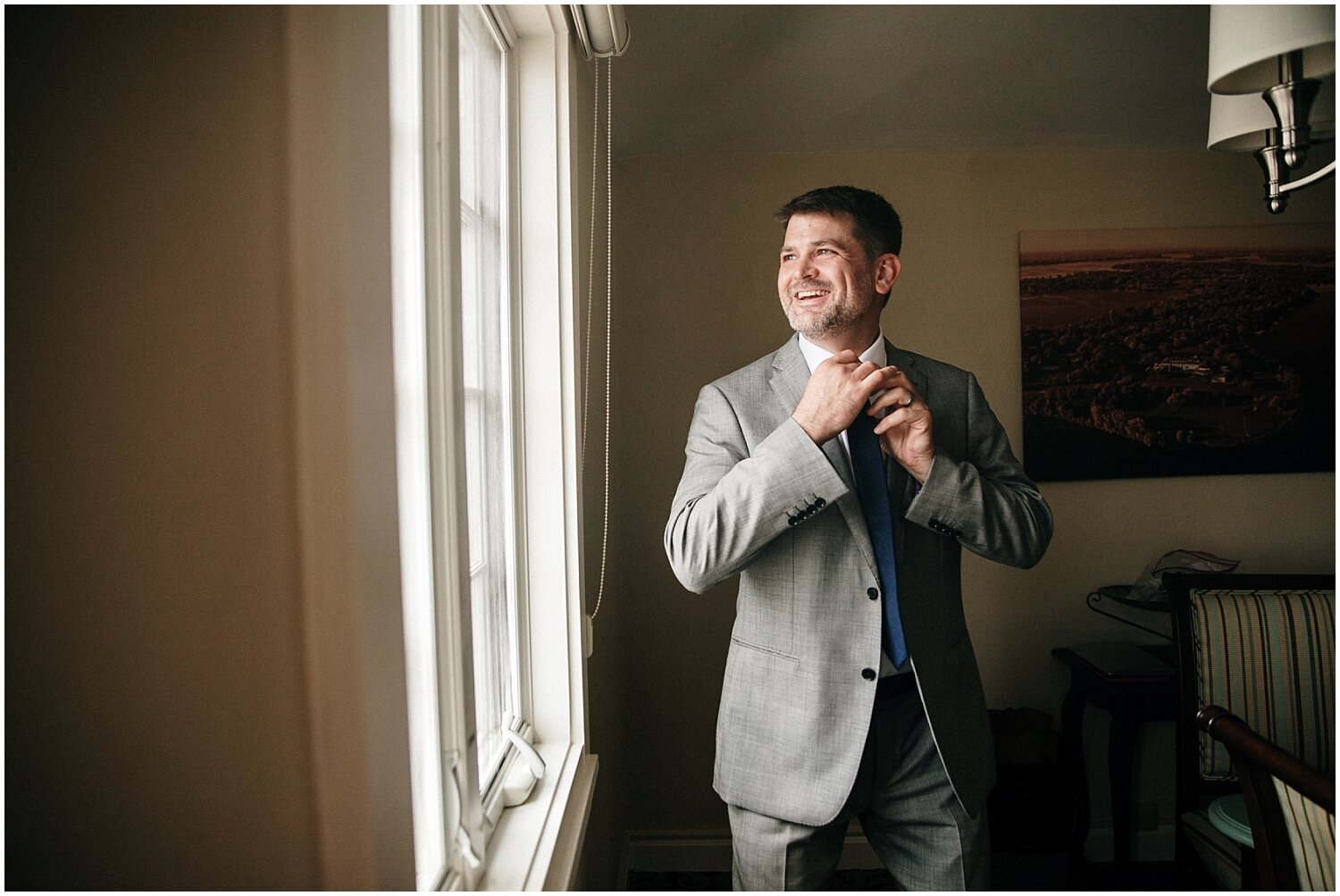 groom getting ready for his wedding in MN
