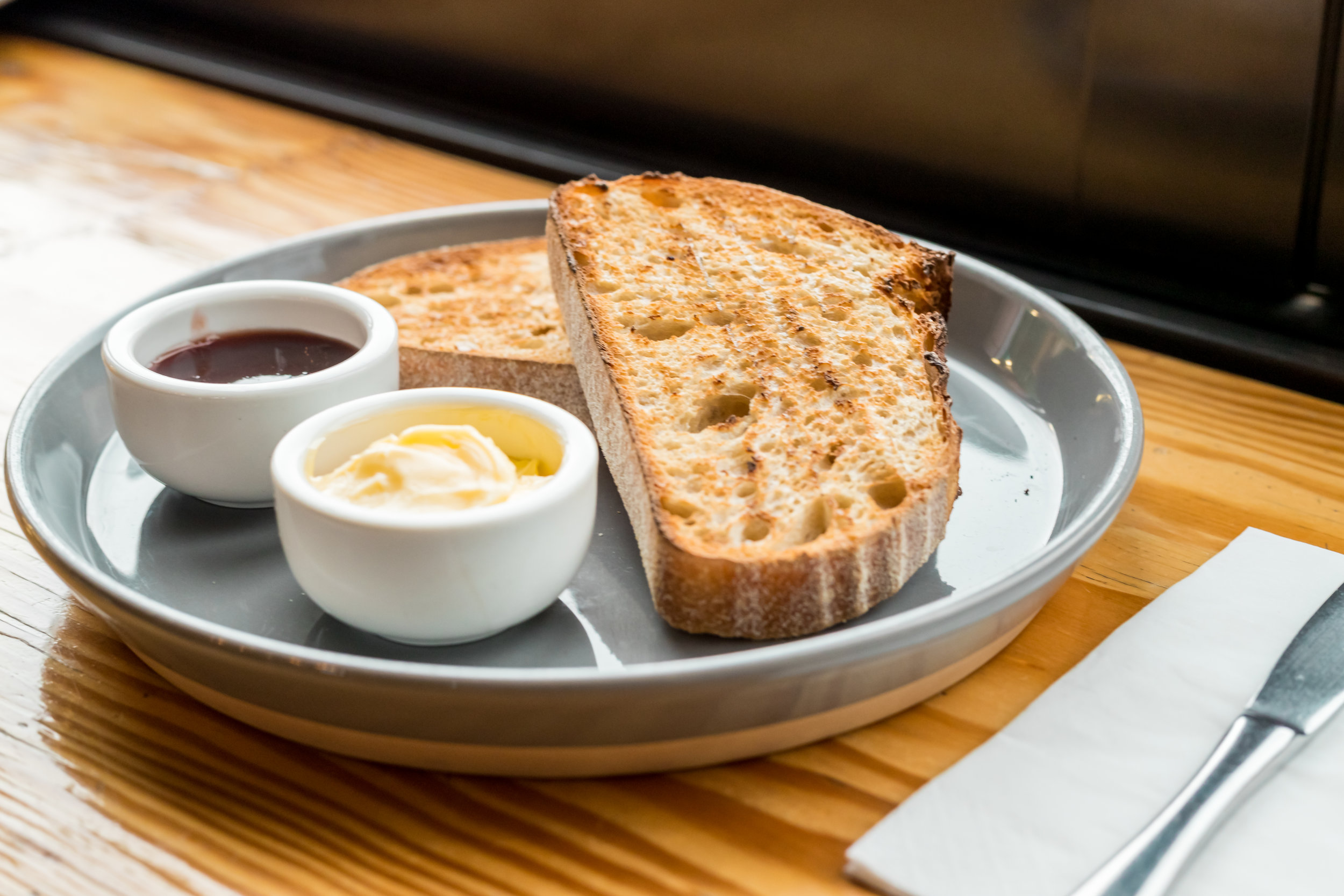 TOAST $8 - Bicycle Baker Sourdough w. housemade jam, marmalade or local honeyGFO