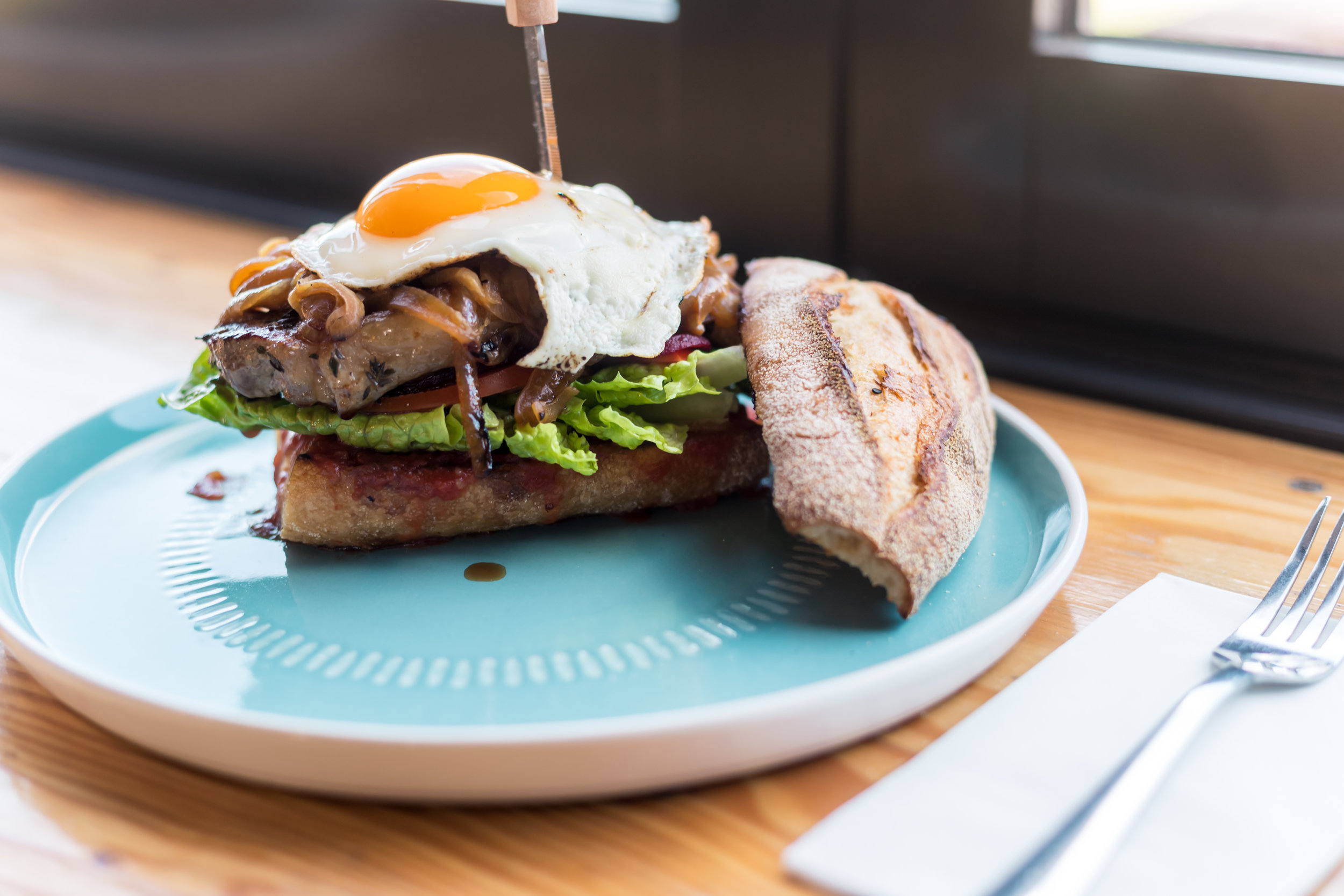 Steak Sandwich - sandwich steak, brown onion, bicycle baker baguette, thymes oil, relish, cos lettuce, sliced tomato, sliced beetroot, egg