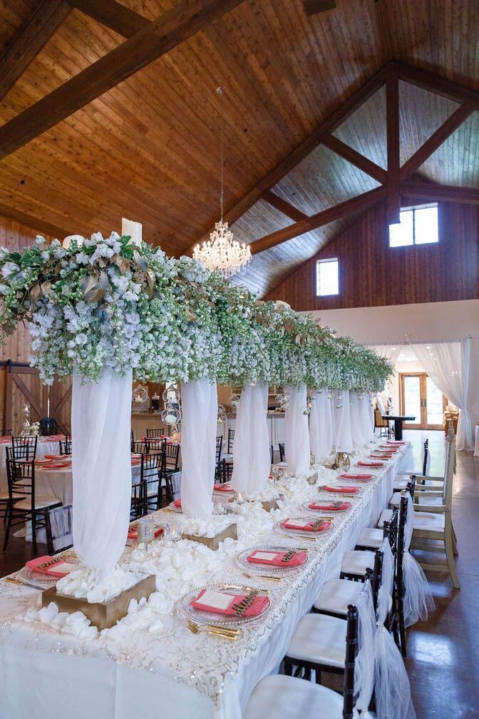 wedding table white, and dark wood chairs.jpeg