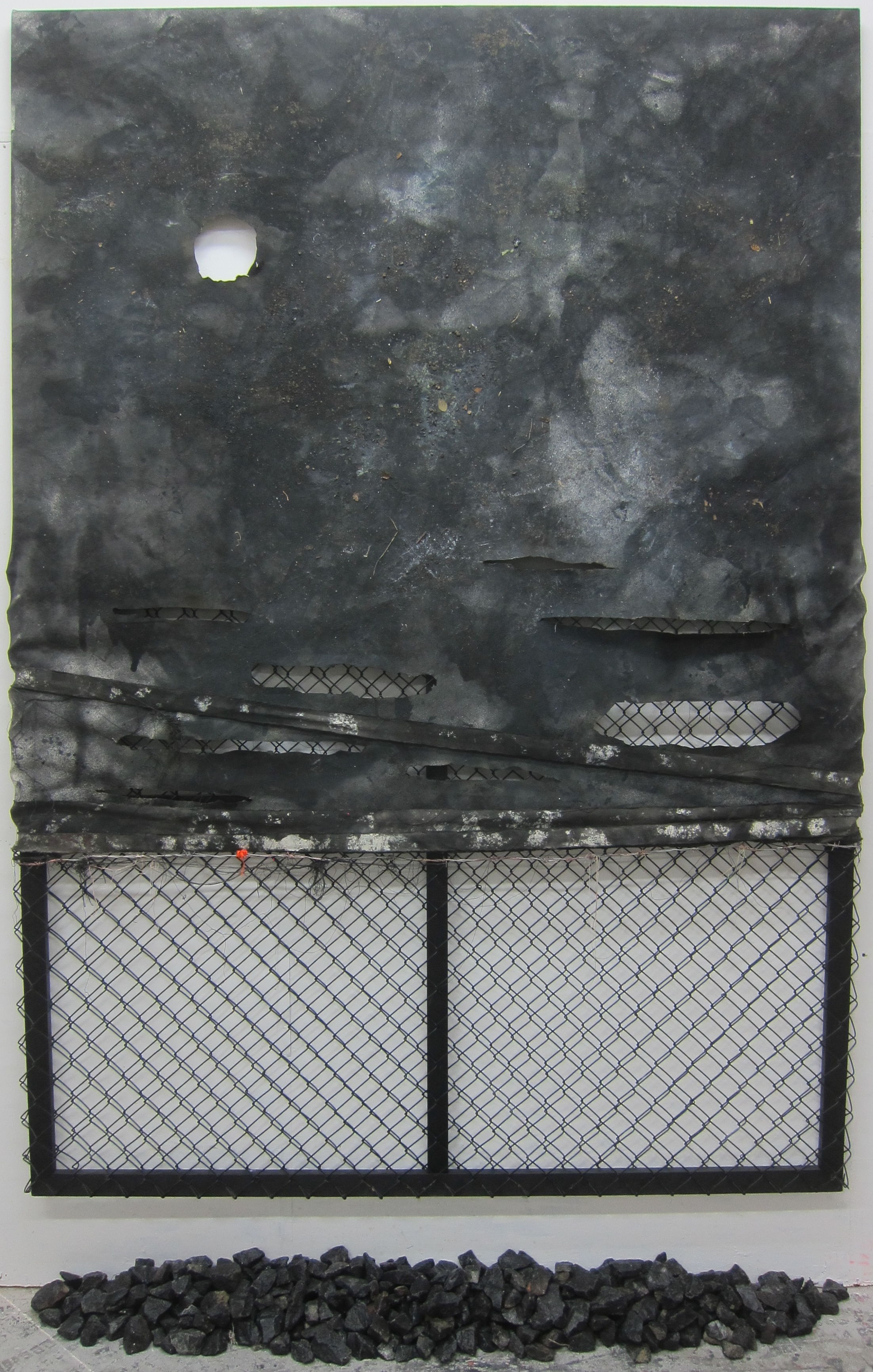 Trespass.   Alkyd resin, ink, soil, barbed wire, polyester, fence, granite, wood, cotton & fire.   260 x 172 cm.  2015.